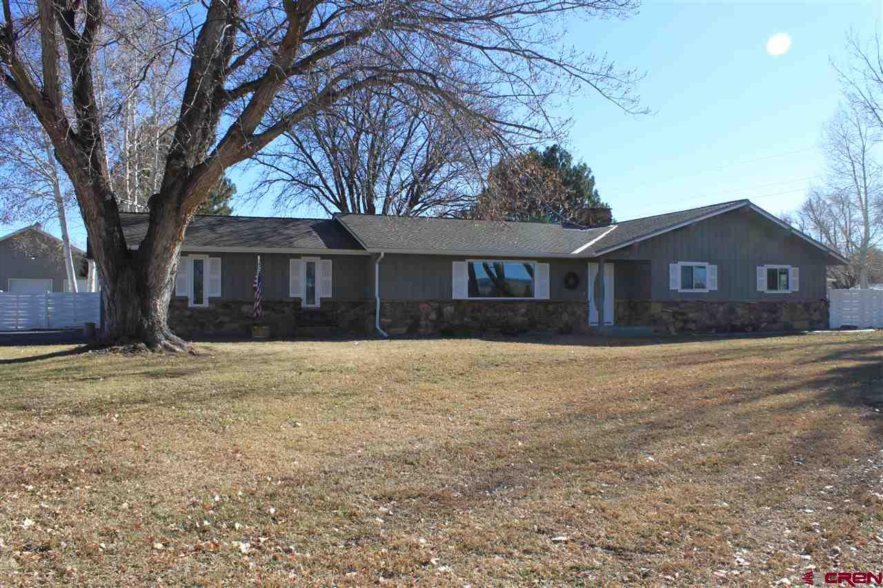 Beautiful 3 bedroom 3,752 sq. ft. home in Spring Creek area with three beautifully maintained and irrigated acres. This lovely home has lots of room to spread out with multiple living areas, a sunroom and other enclosed spaces. A large wood burning fireplace in the dining room and kitchen area, plus a gas fireplace in the family room. The property includes private back yard with gazebo and hot tub, pasture area, green house, garden area, and a huge 68' x 42' heated shop/garage, and a 20' x 42' Pole Barn. A perfect set up for lots of trucks, machinery or equipment. The Morton building is fully insulated, heated, and can be a multi purpose building. A perfect location to be in the country yet close to town.