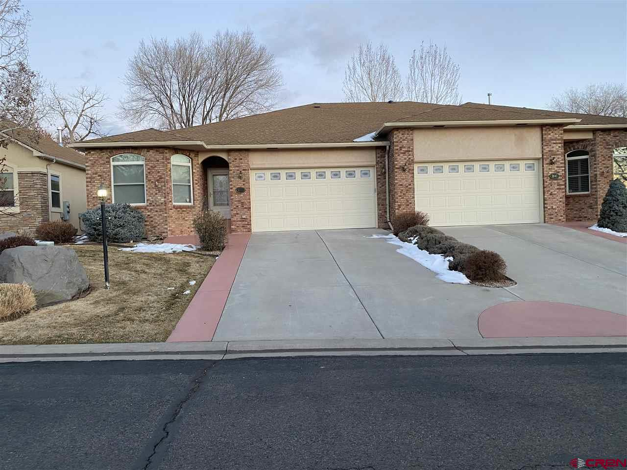 Clean and Move in ready Townhome on the Cedaredge Golf course. 2bed/2bath home with an office and Big master bed and bath. Nice layout with over 1700 sq. ft. and an attached garage.