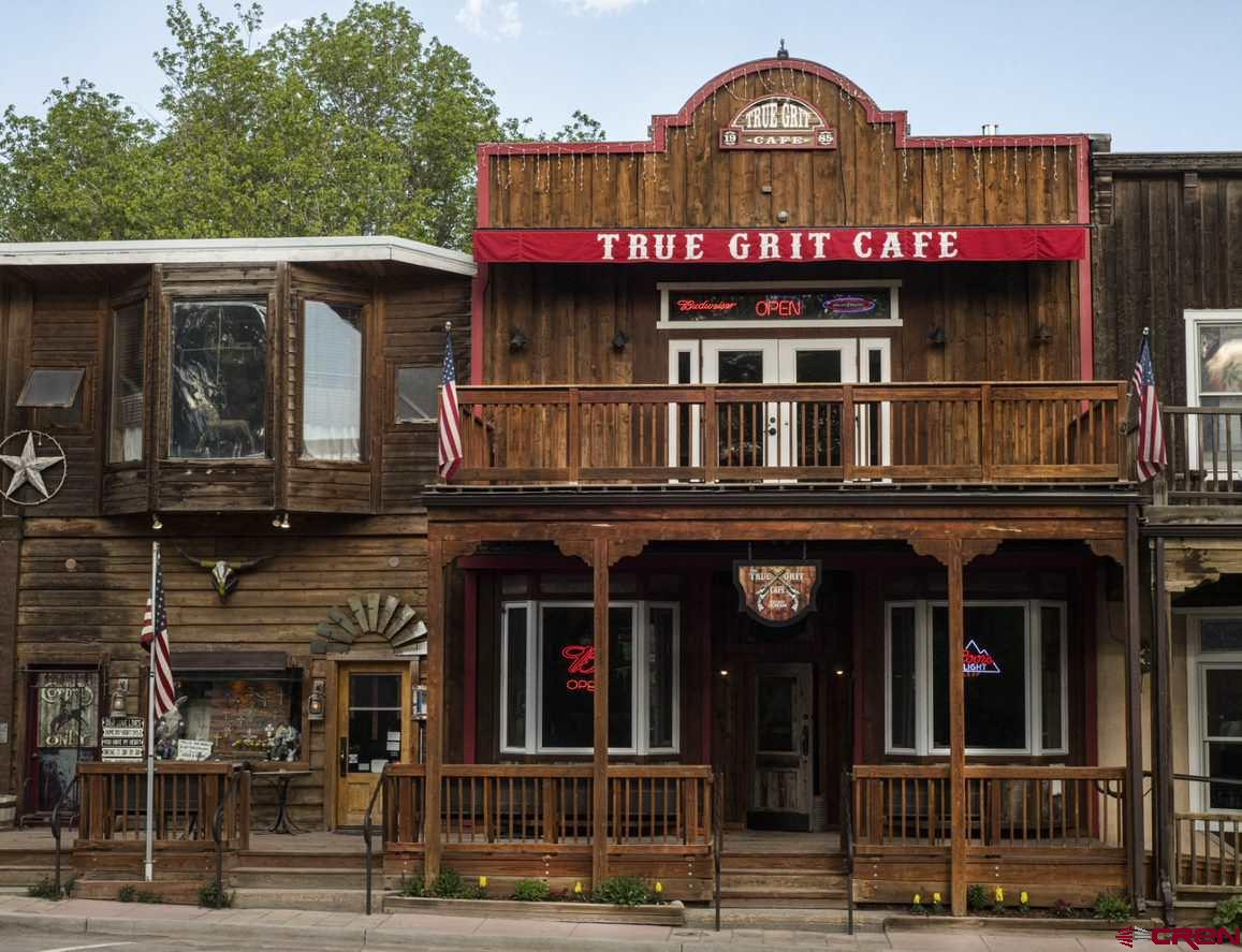 """The historic True Grit Café is a turnkey opportunity you can make your own!  Located in the heart of Ridgway on the Goldbelt of Hartwell Park.  This location is high traffic and well known by locals and tourists alike.  True Grit was started in 1986 and has been an iconic restaurant in Southwestern Colorado ever since then.  The café pays tribute to the """"old west"""" with art and décor and in fact has been the center of the Old West Fest which has been held every autumn in Ridgway for several years (excluding 2020).  This thriving business has a 7% cap rate and there is room for increase. Even with the covid pandemic, the loyal customer base has kept the restaurant profitable and the revised business model has even increased numbers and with less expense.  True Grit offers not only dine in and take out but also a $250,000/year catering service. In addition to the restaurant, there is room to increase profits/income by expanding on site to add employee housing – a definite need in the Ridgway area.   Purchase price not only includes all inventory, stellar reputation and management systems in place but also a transition/training period to help the proud new owner take over and proceed with ease.  If you are ready to live in one of the most beautiful places in Colorado and escape the rat race of the city, this is your opportunity to enjoy life while continuing a long tradition of excellence and history.  Are you ready to see your dreams of living and working in Ridgway come true?  See this today!"""
