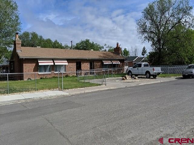Remodeled in 2012. Hard wood floors, tile in kitchen and baths, laundry rooms. Evaporative coolers installed. Newer appliances in each unit. Some Washer/Dryer tenant owned. Each unit has a large private patio.  Unit 601 has detached 2 car garage. Unit 605 has 1 car garage. Garage completely re-sided, re-roofed with metal in 2016.  Each unit has a brick fireplace with installed pellet stove. This is a very nice, easily maintained all brick duplex. The yard has a zoned sprinkler system. The property is fenced.  Owner will carry short term 3 years 20% Dn on Approval.  Any offers should contain 1031  Exchange language. The Seller may do a 1031 Exchange