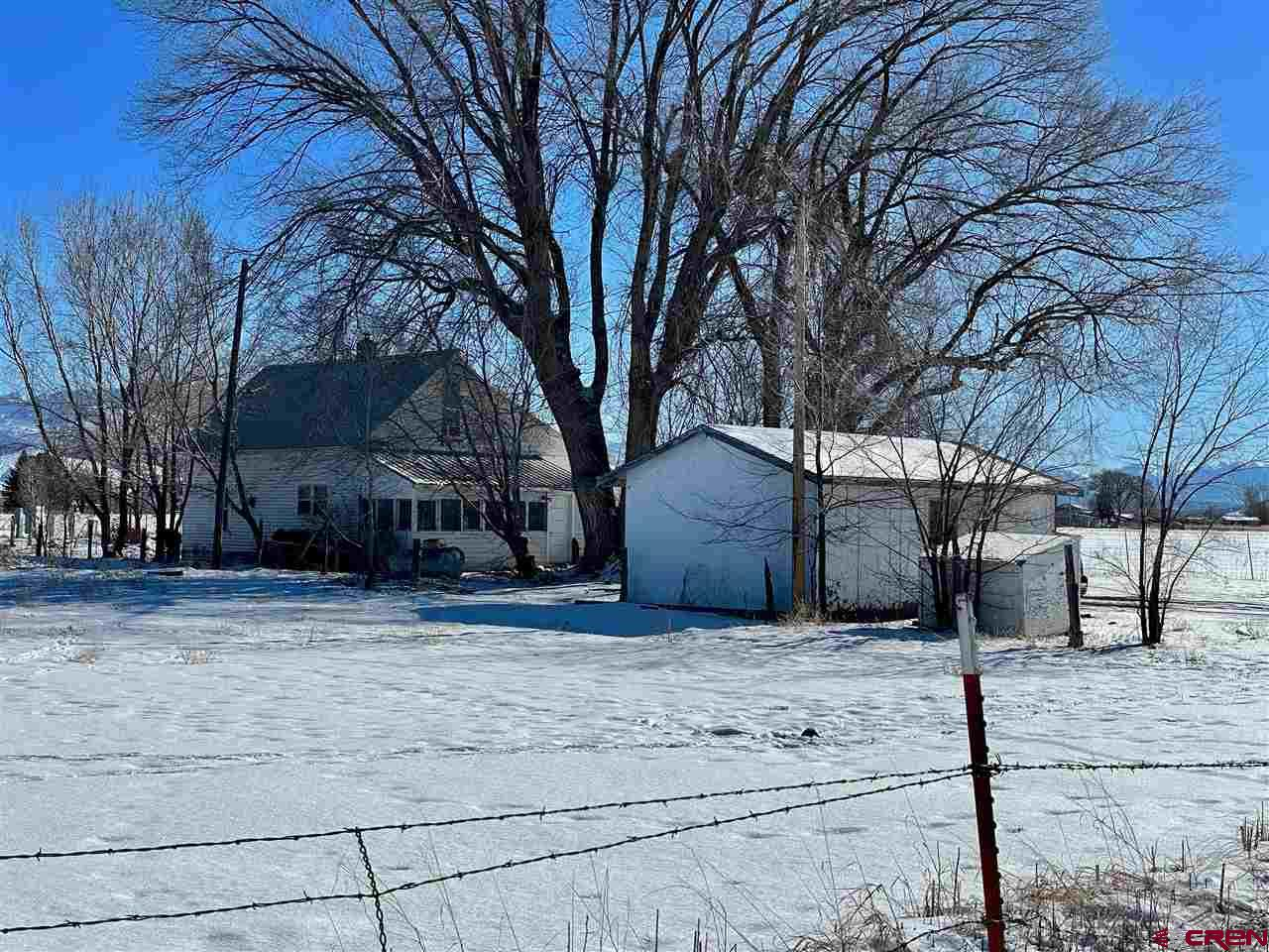 Only Four Miles South Of Montrose, entering from a separate acceleration/ deceleration lane, quaint farmhouse on over 12 acres. This 3-bedroom, 1 bath farmhouse has so many different options. Possibilities are in the eye of the buyer. Use this property as your own home with space galore on the 12.48 acres. Subdivide this fantastic frontage road property and have an income producing rental and possible business sites! Better yet, add this property to the purchase of 18425 6600 road and own two amazing parcels of farm ground, as well as two homes! The possibilities are endless. This property wont last long. Schedule a private showing before it's gone!  This property requires 24 Hour notice before showing.