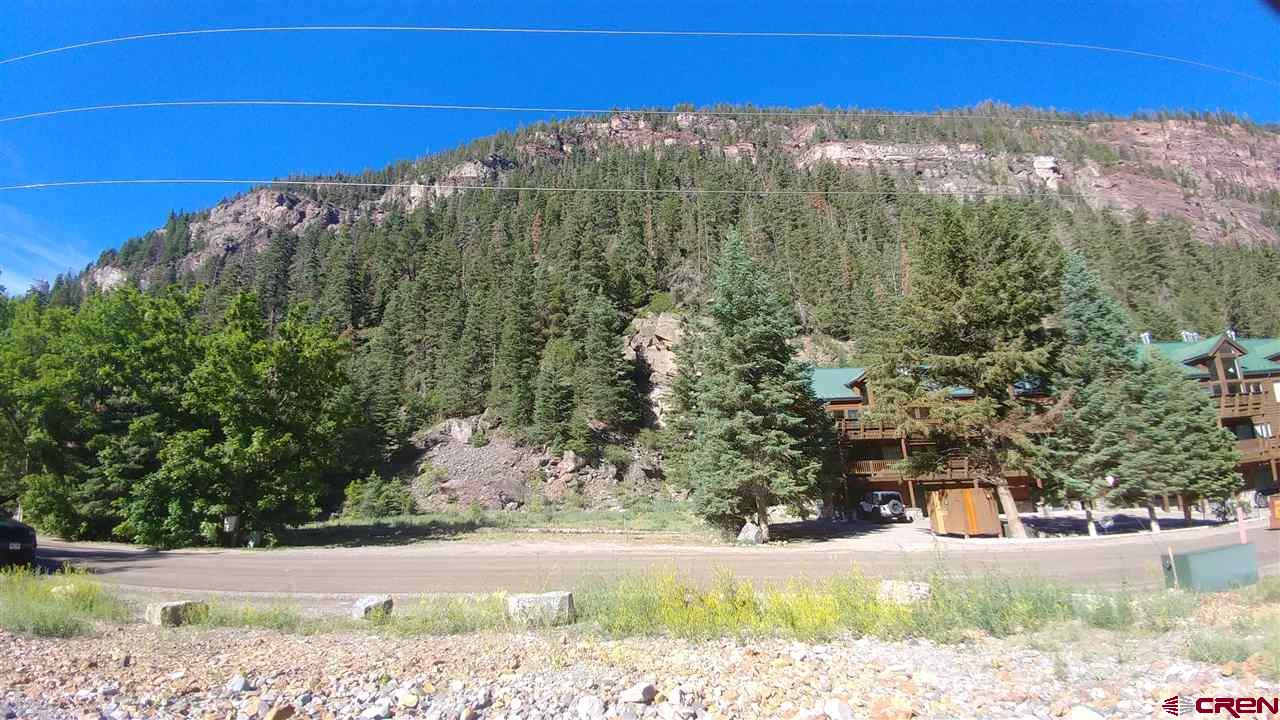 Development or trophy home parcel on Oak Street in Ouray CO. This 5+ acre parcel could be a single family home, a site for condos or townhomes, or other uses allowed by the R-2 zoning. Walking distance to all services in town. Utilities in the right of way. Borders National Forest and across the road from the North Ouray Corridor River trail and Uncompahgre river.