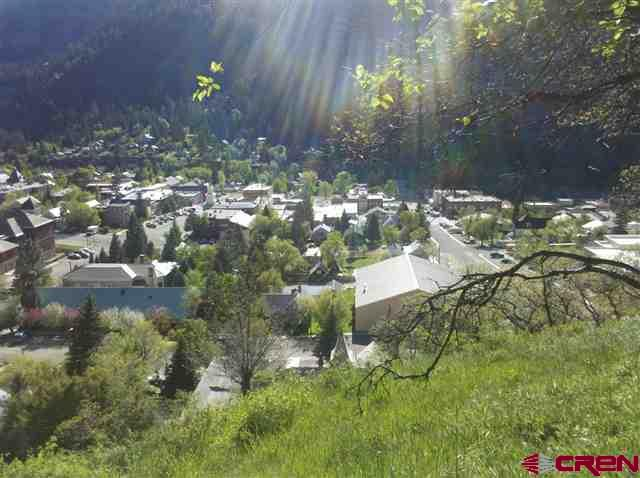 This property has tremendous views over town.  It is two buildable lots so could have one or two homes on it.  Seller can construct an access and pull utilities as well as construct your dream home. Access is across a hill but the property has some land that can be built on. This could be the premier trophy home location with world class Southwest Colorado mountain views in the City of Ouray with a private setting.
