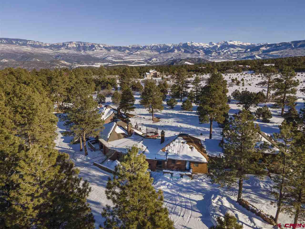 This brand newly remodeled, sunny, south facing condo looks more like a mountain cottage separated by a garage to either side for privacy and quiet. Located in the Loghill subdivision of Ridgway, it has nice southern views of the Cimarron Mountain Range from the upper and southern decks. In addition to the interior remodel that was completed the first week of January 2021, the condo has brand new LG appliances. 79 Meadow Estates has 2 bedrooms, 2 baths, fireplace, one-car garage, two parking spaces, open floor plan, vaulted ceilings, a flex room to use as an office or 3rd bedroom, laundry room, low taxes and low HOA dues that includes septic and plowing.  Located 7 miles from Ridgway, and 50 minutes from Telluride. Imagine walking out your door to cross country ski, hike, bike on miles of trails—and there is a golf course in the Loghill subdivision. School bus service is available. There are 5-condo units in a semi-circle bordering Open-Space lending to quiet and privacy. Common space is treed with pinyon, juniper, cedar, and sage. All units are owner-occupied.    General Home Points: • 1032 square feet with 16-foot ceiling •  Cute cottage style home • High speed internet • Fire mitigation recently performed • Cedar siding • Recently replaced roof • Recently replaced water heater • Recently replaced carpets in bedrooms • Wood floors refinished in main living area • Slate style floors in the kitchen, bathroom and entry way • Radiant heat • Modern wood fireplace in living room • sunny and light • 2 parking spaces and 1 car garage with storage/mechanical room • Flex Room: Heated Office/Bedroom is situated off garage can be used as bedroom.  Perfect for a small family or couple or individual wanting to take in everything the area has to offer.