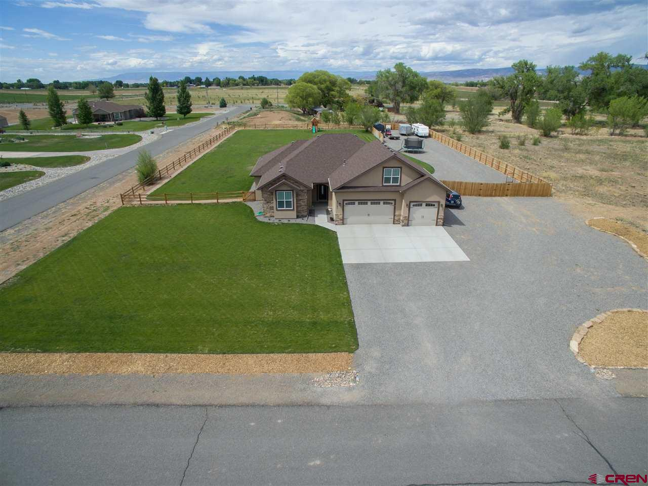 Imagine your life in a country setting, close to town, wildlife passing by, beautiful sunrises and sunsets all to be enjoyed in your beautiful custom home.  Inside is the perfect mix of style and function with room to work from home, or room to enjoy your favorite pastime.  The well designed and efficient kitchen showcases a five burner gas range, granite counter tops, and beautiful cabinetry that reach high into the ceilings and are enhanced with soft close mechanisms.  Large laundry room is strategically located as you come in from the garage.  The owner's suite with stunning trayed ceiling and spa-like bath give your a personal hideaway when you need a break. Two additional bedrooms and a bonus room leave all sorts of space for company, crafts or guests.  A bonus room over the garage could easily become a quilter's paradise, or a theater room.  Outside, enjoy the ease and space of being somewhat self sustaining with raised garden beds.  This is more than just a house, this is a lifestyle.