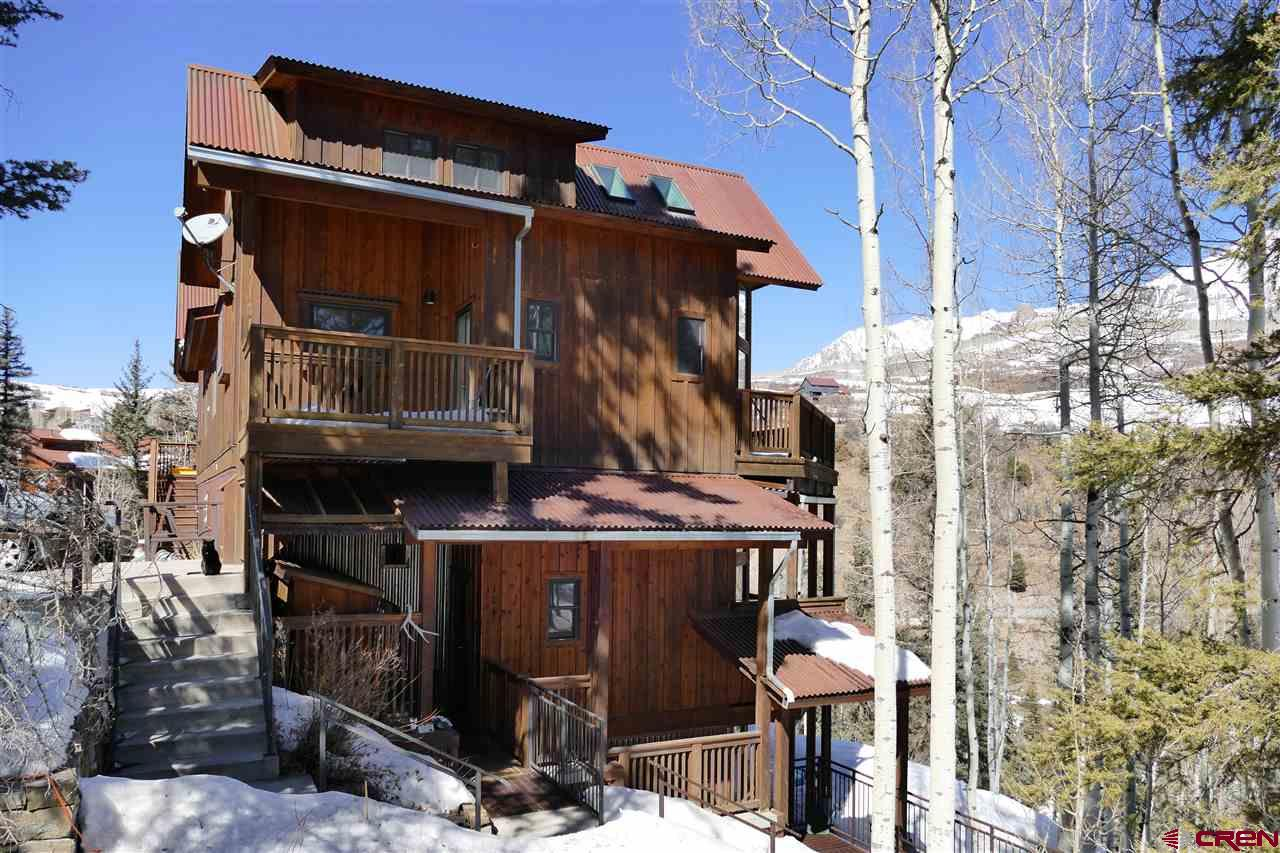 Deed restricted local housing opportunity in Lawson Hill. Quiet and private, this two bedroom condo has 10' high ceilings with big windows and huge views of Campbell Peak and surrounding mountains. The condo has an awesome outdoor patio and is a short walk to bus stop and other neighborhood amenities. This home was remodeled in 2010 and has in floor radiant heat along with a really great open floor plan. This is great opportunity to own a really nice space in Lawson Hill.