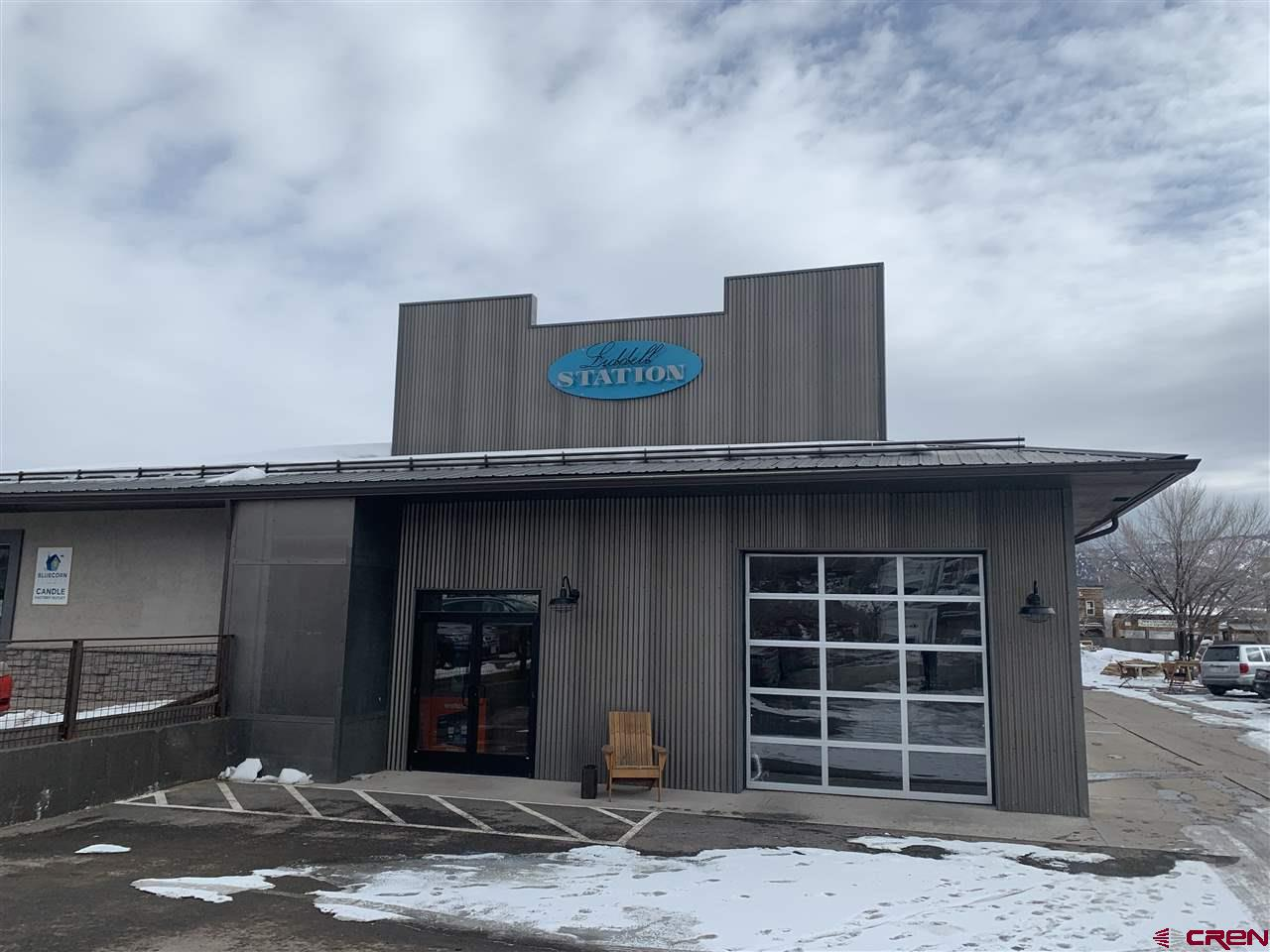 7735 square feet of Commercial improvements on a 21,736 square foot lot in downtown Ridgway.  The improvements have been recently remodeled and upgraded into one of the nicest buildings in Ridgway.  There are 4 separate Units with flexible potential for future use.  This is a prime location East of Liddell which could allow for cannabis based business. General Commercial zoning will allow for multiple uses (check Town of Ridgway land use). Buyer to verify with Town of Ridgway as to any potential desired use.
