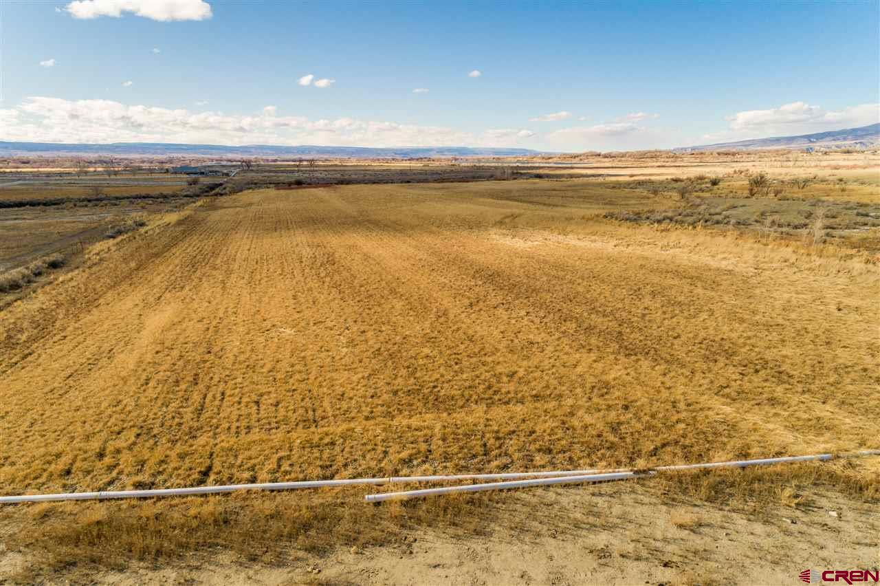 17 acre flat Land in the Country waiting for you to build your dream home.  No Covenants or HOA's.  Property comes with 10 Shares of UVWUA irrigation water.  Tri-County Water tap and installation has been paid for.   DMEA is in the process of running the Electricity to the Property.  Black Hills Gas stops at the neighbors to the South of the land.  Come take a  look at the 360° views.   Unobstructed views of the Grand Mesa, Sweitzer State Park, Black Canyon of the Gunnison and the San Juans in the distance.