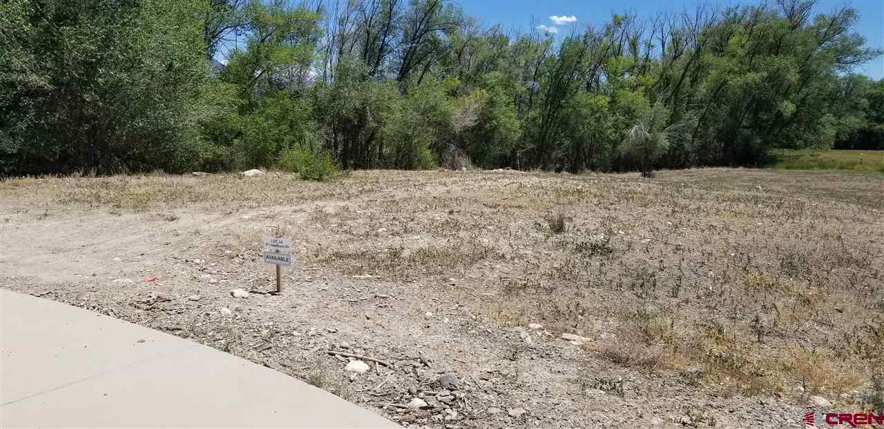 Nice-sized residential lot in the North Ridge Meadows subdivision on Barrow Mesa just north of downtown Hotchkiss. The south-facing lot is within the Hotchkiss town limits and has water and sewer taps already installed (buyer will need to purchase them from the town). At the end of a quiet cul-de-sac with views of Mt. Lamborn and the West Elk Mountain, the lot comes with  wheelchair-friendly curbs and sidewalks.