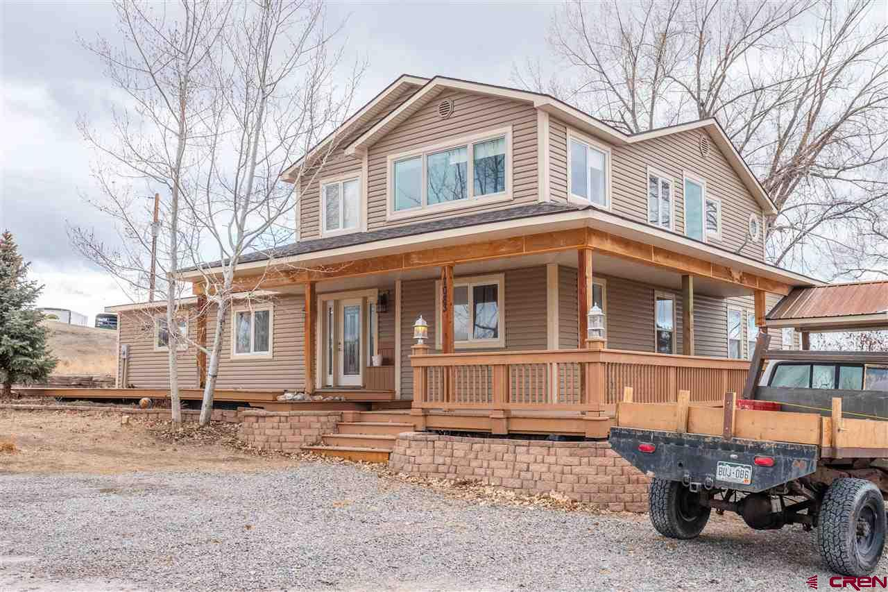 If you love the country, VIEWS and peace and quiet, have your own oasis, only minutes from downtown Montrose, do not miss home.  No HOA, and almost 9 acres of your very own, to do whatever you want with.  Out buildings, corrals, loafing sheds, TWO PONDS,  two car detached garage with room for a shop.  Enjoy the wrap around deck with large expansive staircase off the back deck leading to your ponds, shade and a lazy afternoon in your hammock. Fabulous San Juan Mountain views.  Oak flooring (the real thing) throughout home, truly an open floor plan with lovely garden sun room with its own door to the outside decks.  Mature garden already in place, plenty of trees for shade.  Home includes 4 bedrooms plus an office, sunroom could easily be made into another bedroom with plenty of privacy.  The ambiance of this home is something you need to see and feel for yourself, a wonderful home to enjoy for many years to come.  Need a little cash, possibility of selling off some acreage;