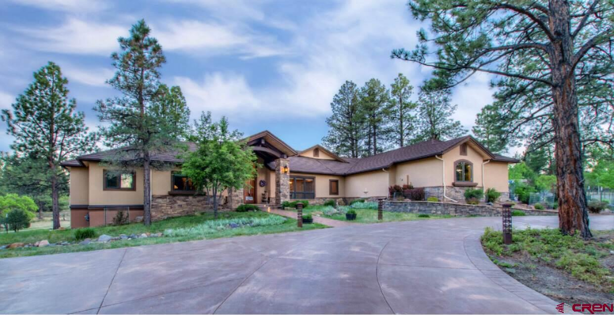 Perfectly situated on the second fairway of Divide Ranch Golf Course, this meticulously maintained home offers a private mountain setting with gorgeous views. The entry way is awe inspiring with the exquisite woodwork, custom french doors and a walkout patio that overlooks the Award Winning Golf Course. The tall ceilings and expansive windows combined with sprawling open spaces gives this home a feel of luxury and comfort.  The huge culinary dream kitchen has Ukraine Volga Blue granite counters, professional Viking Range, an oversized Versailles Farm sink and intricate cabinetry.  It has everything a gourmet chef would desire.  At over 5,900 sq. ft. of living space, the open concept accentuates the high ceiling height and warm wood hues.  Boasting 5 bedrooms, an oversized heated 3 car garage, a home theater,  an entertainers bar, a workout room and much more.  Come see what livable luxury feels like at this admirable Golf Course Estate!