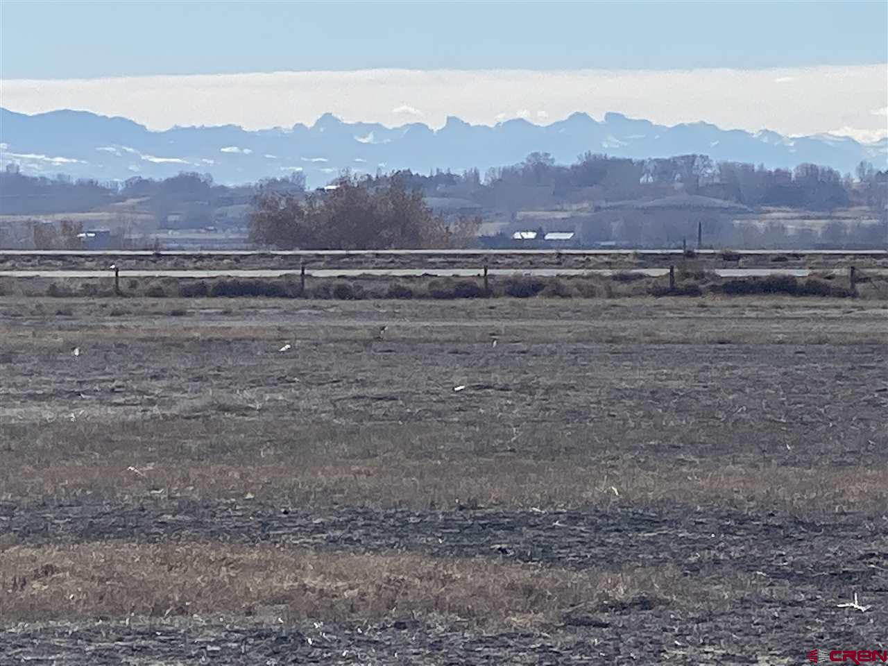 Located near Delta Colorado, This 1.7 Acre lot in the Westwinds Airpark offers one of the last lots located directly off main runway, with pre approved direct access (to be built in the future) to the main runway. This lot has great views of the San Juan Mountains and the Uncompaghre National Forest. Just a short drive to Public lands this lot gives the outdoorsman plenty of options and the pilots the ability to keep their aircraft at their home. Landscaping irrigation is provided through the HOA and is located at the corner of the lot.