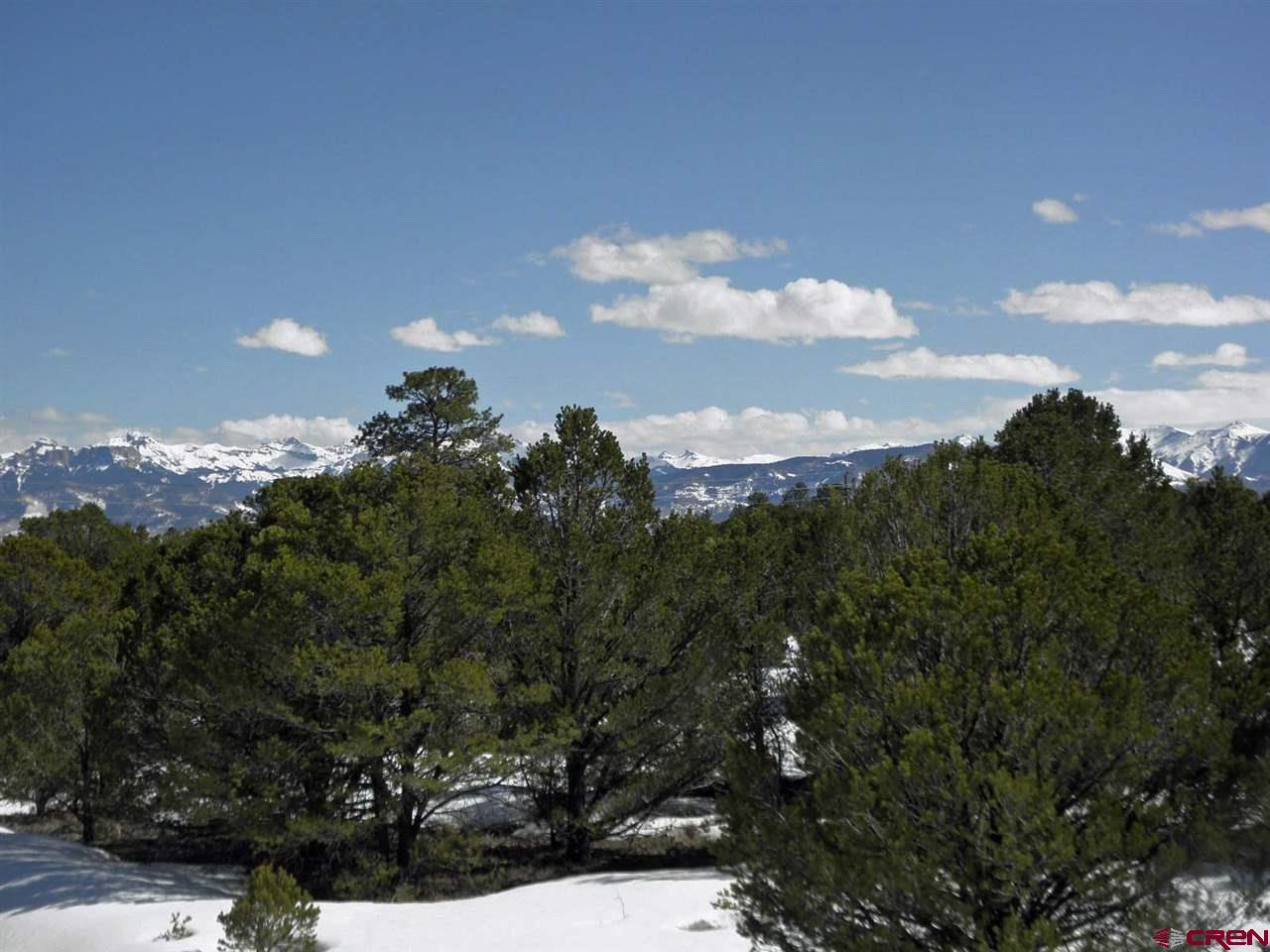 Great Views of Sneffels and Cimarron Ranges of the San Juan Mts.  on a private 4+ acre property.  Mature Ponderosa Pines and Pinion Pines.  Lots of great building sites on the property.  Paved road access.  All utilities under ground to the lot line.  This is one of the best lots in the area.  Make sure you see this lot.  All of the photos were taken on the property at various locations on the lot, some from the ground and some from a ladder.  The second floor of the house you build on this lot have almost 360 degree views, Mt. Sneffels, Cimarrons and all the way to the north to Grand Mesa.