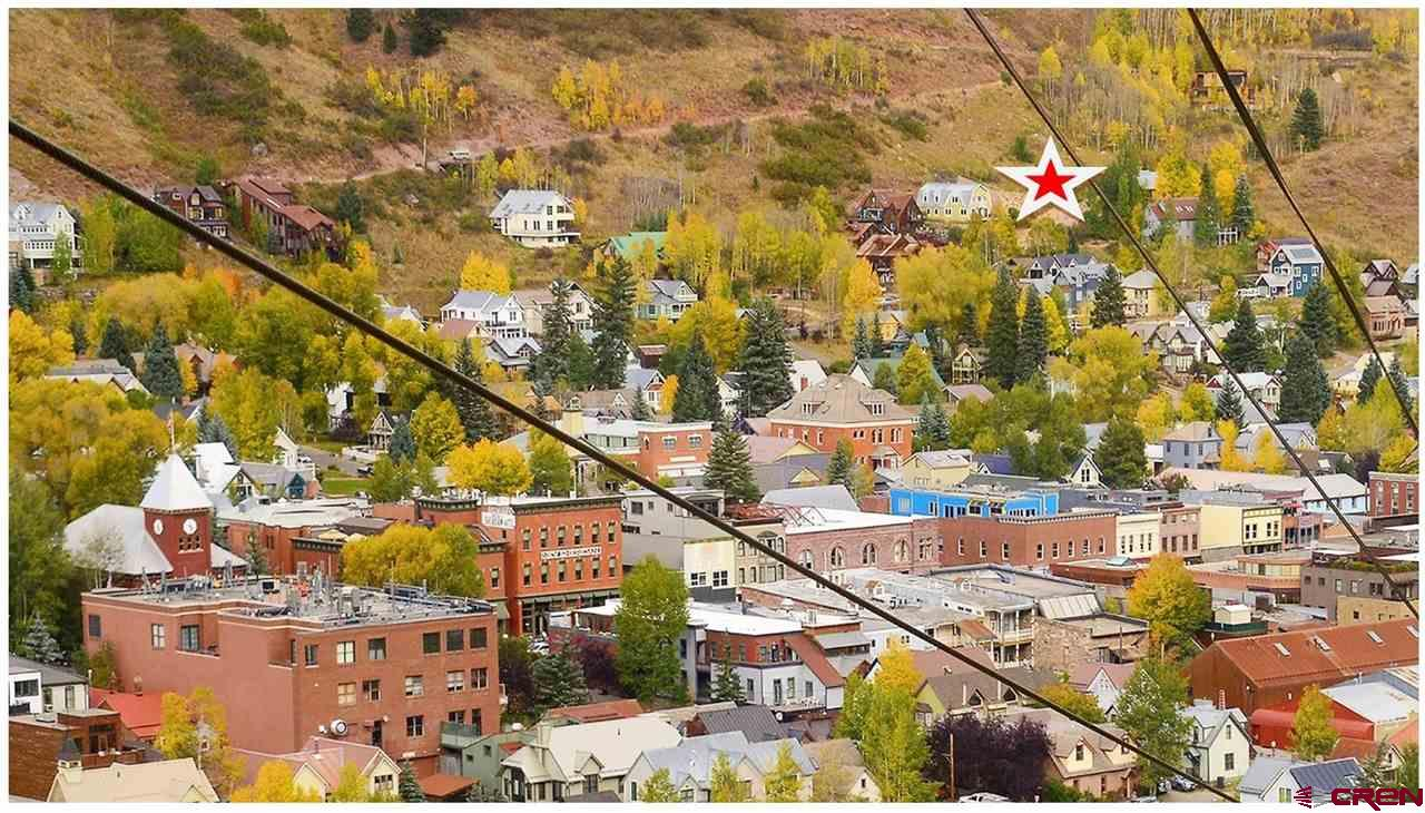 Easily one of the best deals in the Town of Telluride real estate market today, you can Land Bank or Build on this extra large lot on the sunny side. Currently the largest single-family building lot for sale in Town. Direct southern exposure opens up amazing views across to the Bear Creek Preserve, Town Park, and the ski runs of the Telluride Ski Resort. At 10,090 feet (.23 acres) there's much more elbow room from the neighbors and design flexibility than most locations in Town. Life on the sunny side of Telluride gets you hours of extra sunshine in the morning and evening compared to most neighborhoods in the Town of Telluride...and way more of the dramatic big mountain views you came here for. Please contact broker to arrange a personal tour of this property. Current survey on file.