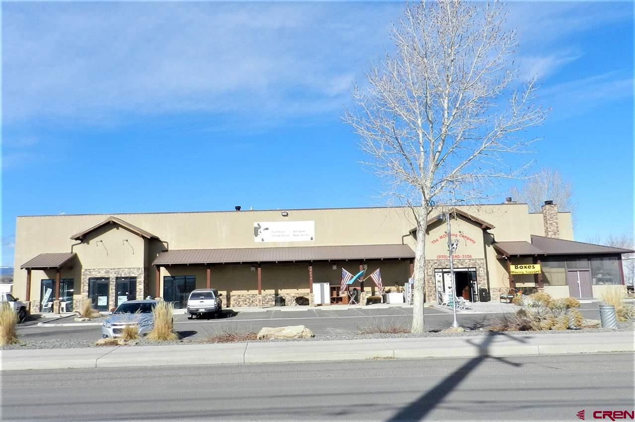 """COMMERCIAL CONDOMINIUMS WITH EXPANSION LOT FOR FUTURE DEVELOPMENT.   Retail/Showroom, Warehouse and Ready to Build Lot!   15,373 sq.ft. (MOL) well maintained, attractive stucco building, with adjacent 1.09 acre (MOL) lot. Zoned B-3 in the City of Montrose, which allows for a large spectrum of retail, warehouse, and customer-based businesses. Building features a large showroom, warehouse space with 3 10'2"""" x 10'2"""" overhead doors, 3 offices, 5 bathrooms (2 ADA), kitchenette, 18' vaulted ceilings, off-street parking and mature landscaping. Added features are an updated fire suppression system and security system consisting of cameras, alarmed doors and motion detector lights. Lot is located at end of a cul-de-sac, level and perfect for development. Property is subject to City of Montrose final plat approval. Units and lot sold together because City's subdivision process needs to be completed. Property listed independently, will require two separate contracts. Purchase would give new owner control of entire subdivision. Located just north of the airport, near DMEA.  Properties listed separately: Unit 101 MLS #779947 $849,888 and Unit 102, 103 & TBD 6300 Rd MLS #754227 $299,888 Incredible tax break with Opportunity Zone designation!"""