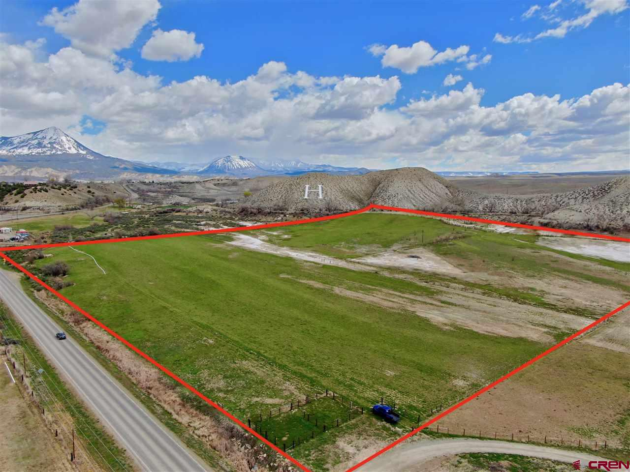 Development or Farm and Ranch Property in Hotchkiss, Colorado For Sale. 30 acres of Agricultural property with extensive development potential, situated just inside the city limits of Hotchkiss. Identified as one of the expansion areas for the town of Hotchkiss, Colorado, it comes with 13 shares of the Short Ditch Water Company, one of the most senior water rights in the entire valley.Also includes 1.0 cfs of year-round spring water running on the northern boundary of the property. The Town of Hotchkiss recently extended water and sewer lines to serve this location, anticipating future growth in this identified expansion area, making this is a prime location for future development. In the meanwhile, the property can continue in its agricultural use, guaranteeing low taxes in the interim. The acreage is adjacent to BLM lands to the South. With the Western Slope ofColorado expanding rapidly, development areas and housing are becoming a looming concern. The appeal of the lifestyle offered in the North Fork Valley draws many, from the beautiful orchards and vineyards to the outdoor recreational draws off ishing, hunting, four wheeling, mountain biking, snowmobiling, or cross country skiing, the North Fork Valley has it all.The town of Hotchkiss has identified areas of expansion for the growing town. This parcel is identified in the expansion area.With no development currently on the property, this is a premiere property in a prime location. Less than a 1/2 mile from town limits, and less than a mile from Hotchkiss High School. New ILC survey from July of 2017. Great development or agricultural property, locate a hemp farm or commercial facility here, a great location situated between Hotchkiss, Paonia, and Crawford farming and ranching communities.