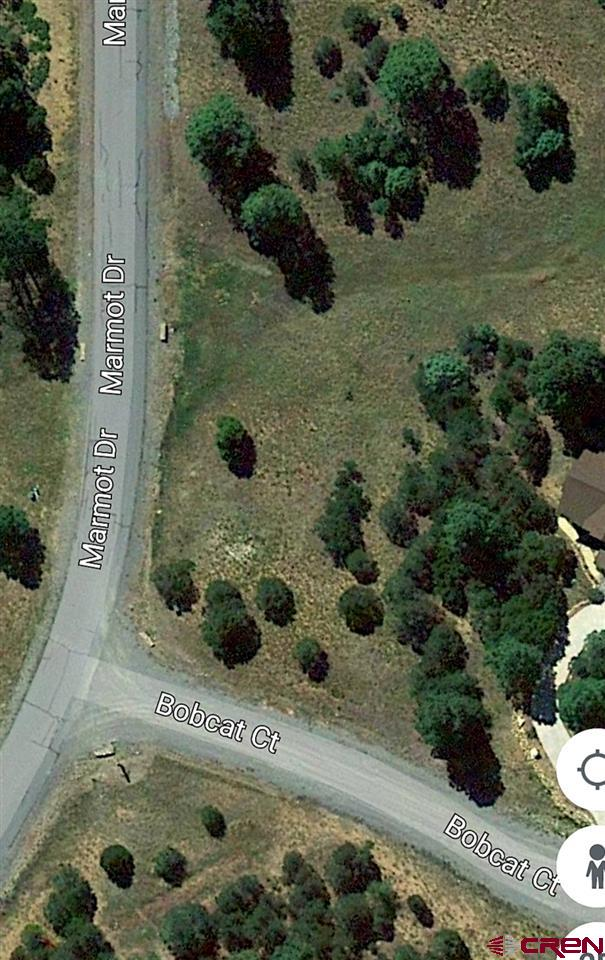 Peaceful quiet setting on corner lot to build your dream home. Lot is on a slight hillside and may be ideal for a lower level walk out. Lot is located within walking distance to the clubhouse. Seller is a general contractor and would love the opportunity to help you design and build your custom home. All utilities to lot. Located just miles from downtown Ridgway. Short drive to both Ouray and Telluride. Buyer be aware of $3000 transfer fee to Divide Ranch.