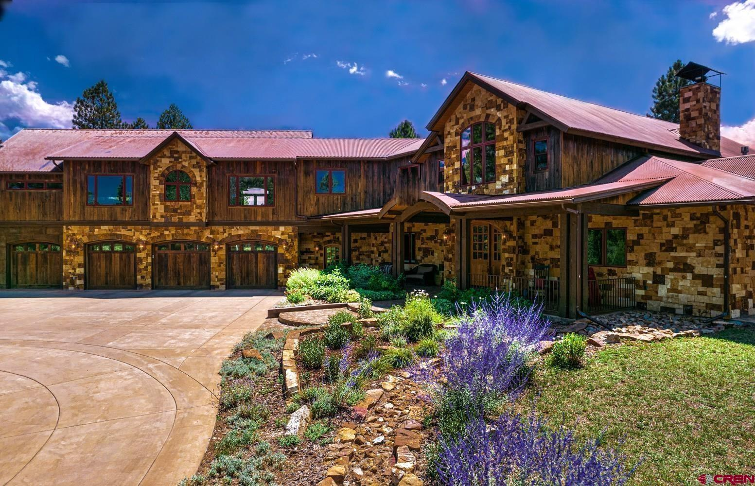 Luxurious Private Mountain Retreat Spectacular 6,281 Sq. Ft. custom home. The privacy and serenity of this property is truly awe inspiring.  Nestled on 5.94 acres surrounded by towering Ponderosa pines and pods of Aspens. Adjoining 50 acres of the Fisher Canyon preserve open space is your backyard. Located at the end of a cul-de-sac you wind down a custom concrete driveway that ends at the front door of your Mountain retreat. Attention to details is what this home is all about.  Native stone, dyed concrete walls and natural woods are just the beginning of what makes this home so unique. As you walk through the grand entrance everything is perfect.  The interior finishes consist of custom milled Alder wood cabinets, doors and trim. Pella window package includes tucked away shades between the panes. The main level features a large office with granite counters, built- in cabinets and double doors for privacy.  Great room with tongue and groove ceilings soaring 20' high with floor to ceiling windows. Hand honed wood mantle with a massive stone fireplace is stunning. An Open floor plan flows to the chef's kitchen with rich granite counters, a Viking gas cooktop, Kitchen Aid refrigerator & double convection oven, trash compactor, microwave and of course a Wine refrigerator.  The Raised granite bar is perfect for entertaining with a spacious dining area that opens to stamped concrete covered patio's and outdoor dining area. The spacious master bedroom is complete with a gas fireplace and stone mantle The master bath has double sinks, his and her closets, steam shower and Kohler jetted tub. Mud room off the 4-car heated garage and large laundry area with lots of storage. Upstairs has a cozy sitting area, two large bedrooms with en-suite baths, plus a recreation room with pool table, basketball/work out area, kitchen/bar, media space and deck. There is plenty of room to store your toys in the heated 3-car detached garage, come enjoy cool crisp mornings as you gaze across the