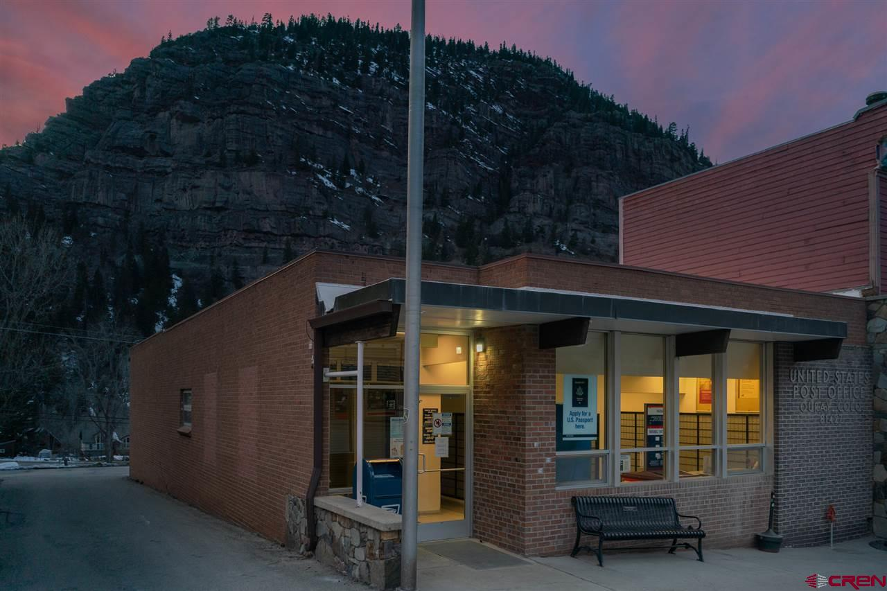 ATTENTION INVESTORS!  Here's a wonderful opportunity to purchase a solid investment in historic Ouray, CO!  This site has been the home of the United States Postal Service since the 1960's. They are the only tenant this building has ever known.  All of the interior fixtures and improvements belong to them except for plumbing, heating, bathroom fixtures, furnace and water heater.  A new roof was put on the building in 2017.  This property is comprised of the building, the parking behind the building, the private driveway adjacent to the south side of the building and parking behind the building to the south.  I can't think of a better investor situation considering the longevity of this tenant and the security of knowing you can have this tenant for years or decades to come! Or, let your imagination run wild thinking of the many wonderful ways you could use this building and phenomenal Main Street location in the future.  Perhaps a restaurant with a rooftop bar or create multi-use with residential by having retail on the bottom and building living space above.  The possibilities are endless and this quaint, beautiful mountain town is a great place to live out your dreams.