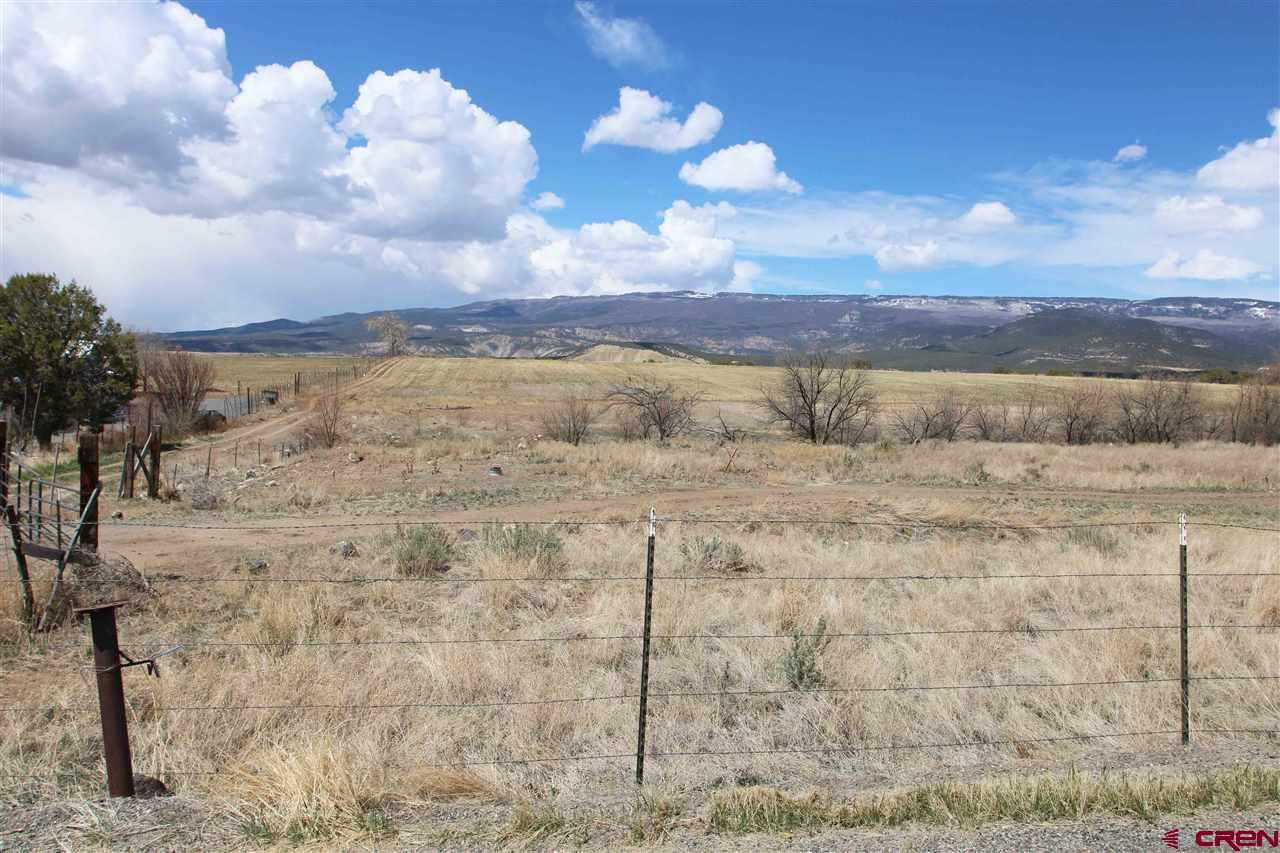 "WATER! – WATER! – WATER!  (1) Domestic water is 3-Party Shared Well, (2) Piped and Gated Irrigation Water (3) Year-Round live running Stock Water providing a delightful stream running through the property.  VIEWS! – VIEWS! – VIEWS!  Panoramic views of Grand Mesa, the Uncompahgre Plateau and the San Juan Mountains. Just a five-minute drive from downtown Cedaredge with a feel of secluded privacy.  If you've dreamed of a home with room for horses, livestock, pasture, a garden, fruit trees or simply that quiet place to savor a view of the beautiful Colorado mountains, FINALLY - ""Your Dream Has Come True""."