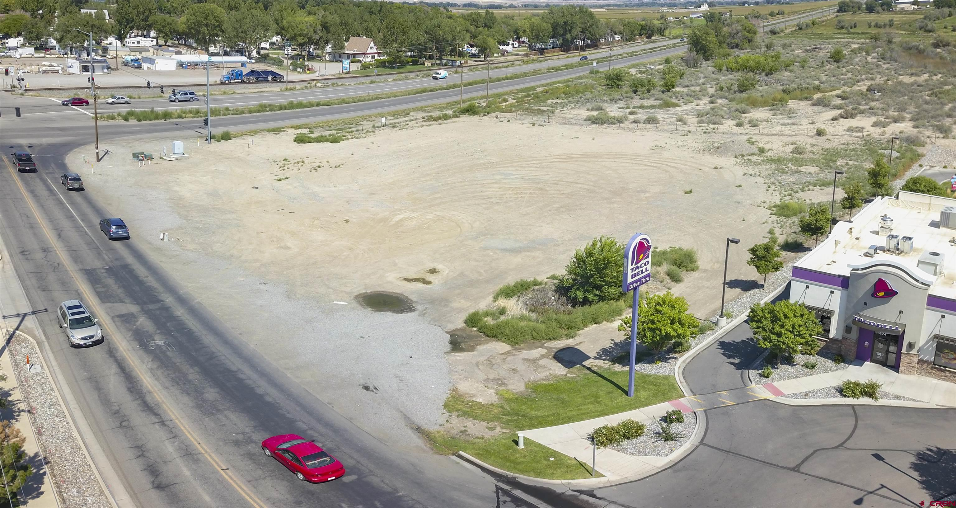 1.78 acre (MOL) vacant commercial lot located in the heart of Delta's commercial hub. Situated on a signalized corner of Hwy 92 and Stafford Lane with 240+ ft of Hwy frontage. Centrally located for shoppers from Delta and the surrounding communities next to the only Walmart shopping center within a 20-mile area. Zoned B-2 in the city of Delta which allows for gas stations, retail or vehicle sales and service, to name a few. Utilities are available. Take advantage of this prime, level lot ready for construction. Incredible tax break with Opportunity Zone designation!