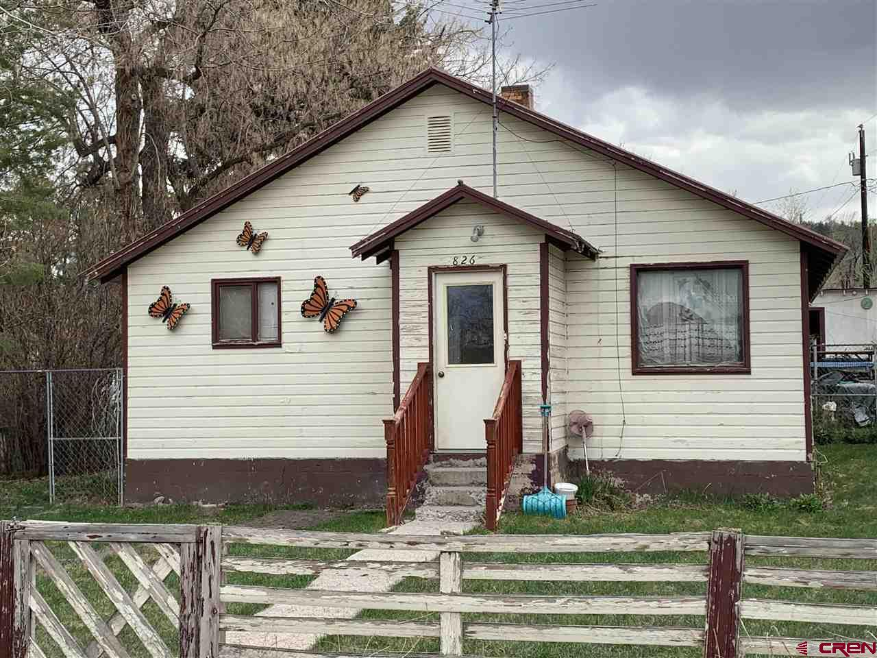 Location, Location.  Here is a quaint home located in downtown Ridgway on desirable Clinton Street.  It's only a couple blocks to the restaurants, theater and brewery.  The home needs a remodel but it has all the bones to be a fantastic place to hang the hat or an investment property.  The desirable location of this property presents a rare opportunity that won't last long.