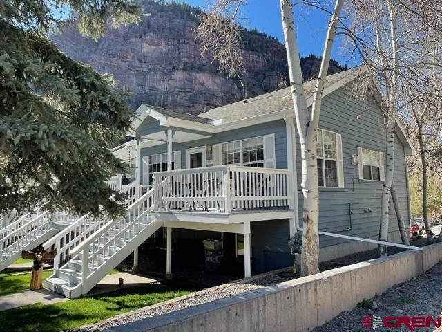 This is an established 2 Bedroom, 2 Bath townhome with attached 1 car garage located 2 blocks West of Main St. in Ouray. There is a small common area with grass in the front of the townhome with large pine trees. Nice views of the mountains from the deck on the main level. The townhome has  been remodeled in 2020 and 2021 with the very best of appliances, wood flooring, kitchen cabinets, countertops , 1 gas fireplace upstairs in the main living area and 1 wall electric fireplace downstairs. Master bedroom carpeting, carpet treads on main stairs and the upstairs bathroom remodel will be completed before a closing.