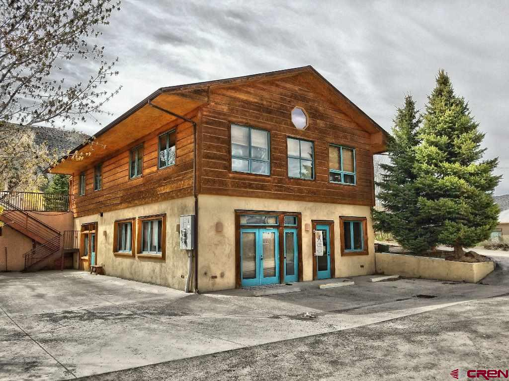 """Known as a popular Health & Wellness Facility this """"duplex"""" flex space is now availavble for office/retail/or?  Great location, on the west end of Sherman across from RIGS Fly shop and Guide Service.  Real estate only for sale.  Medical/office building previously housed up to 9 tenants, on two levels, under the business name """"Ridgway Integrative Medicine"""".   (Some practitioners are still occupying the upper level on a moth to month basis.)  Main entrance off Amelia provides access to front desk and waiting room areas.  A center hallway accesses 5 therapy rooms/offices.  Lower level has a fitness room, equipment room, a second bath and 4 additional office/therapy rooms.  Plenty of parking on both levels and access to a back alley from lower level lot."""