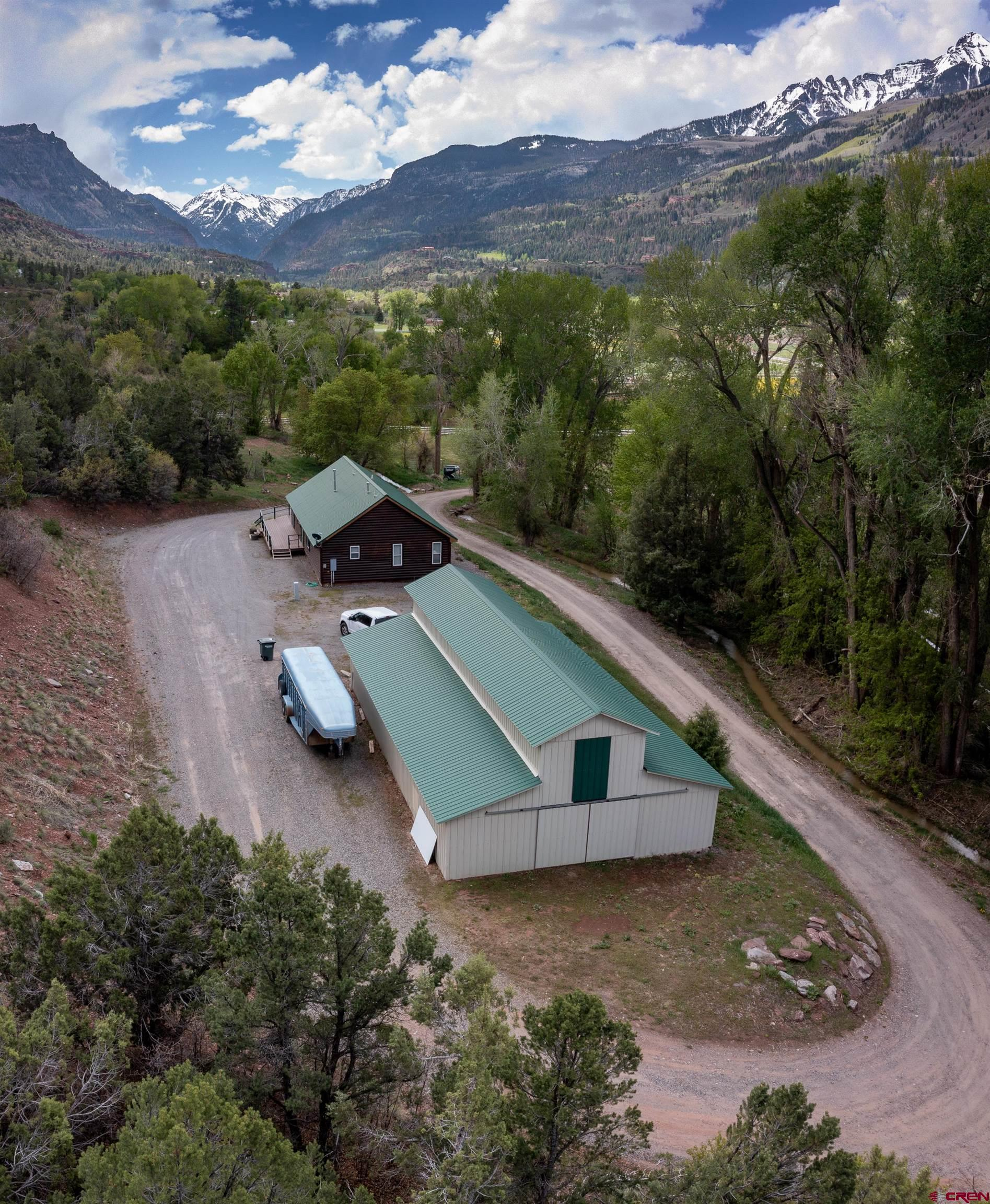 Equestrienne lovers dream property. 36+ acres of land that backs up to BLM land, 14 irrigated acres of pasture, 32' X 60',five horse stable with tack room and storage room, 24' X 24' garage that is now being used as a wood shop and a massive 80' X 175' clear span riding arena. This arena has 14,000 square foot. Perfect for exercising your horses in the winter. The property is stunning with old growth cottonwood trees, red cliffs and green pastures. There is a very well maintained modular home with three bedrooms, two full baths and a nice laundry room. The house has an open concept with tile floors and a nice soaking tub in the master bathroom. Bay windows in the living room and master bedroom along with a tray ceiling and beautiful sconce lighting and two walk in closets. There is a nice trex deck on two side of the house and log siding making it look like a little log cabin. Live in the house and build your dream trophy home. This property backs up to BLM.  All of this with beautiful views of Mt. Abram and White house peak and the surrounding mountain sides. Come see what this property can offer you and your family.