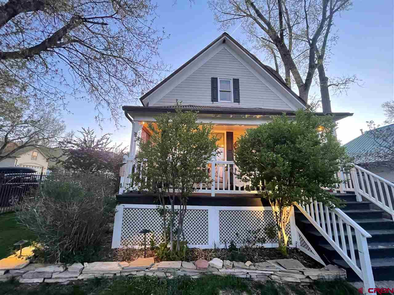 Unique, fully renovated, historical home in the center of downtown Ridgway. Located on a double corner lot with full Cimarron mountain views. Manicured, sodded lawn with Rainbird Sprinkler system for easy upkeep. The property boast mature trees including apple, cherry, aspen, lilac and cottonwood. There is new steel post fencing in the front and full privacy fencing in the back. New concrete pathways and patio allow for easy snow removal and are great for outdoor dining and entertaining. The firepit and sunshade posts complete this backyard getaway. The entryway has new cast iron hooks & leads to a full laundry room with a sink. Living room includes built in TV cabinetry with large east facing windows with unbeatable mountain views. Sliding French doors lead to a quite reading nook & newly posted deck. Full bathroom w/ clawfoot tub, shower and granite countertops. The kitchen is large, bright and fully renovated with new black stainless appliances, granite countertops, custom glass cabinetry, and a comfortable dining area. Upstairs has a large guest bedroom, flex room, and master bedroom with his and her closets. Master bath has a large jetted tub and walk in shower. There is a large fully finished basement which includes two bedrooms each with their own living room and a 3/4 bath with steam shower. The walk out doorway and lock off option make this space an ideal rental unit for additional income. In-floor heat keep the home cozy all year long. Two car garage has a woodstove and makes for a great workshop. Plenty of attic space for storage.  roof is less than10 years old and hassle free.