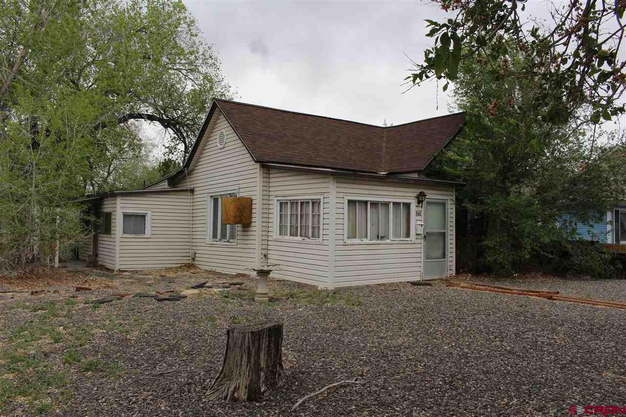 Located in the heart of Delta, this charming rancher sits on a large corner lot with a large fenced yard. Great potential with a high ceilings, enclosed front porch, mud room, full bath, and detached shed. Come see why this is a great value!