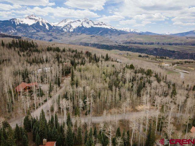 This large corner lot is an excellent site for a new home with just a 10 minute drive to downtown Telluride. This site offers privacy, old growth aspen and fir forest, and a great view corridor to the San Sophia mountains. The 1.4 acre site is gently sloping and usable, providing flexibility on build site. Perched up high just above Mountain Village, this property has excellent sun exposure year round with the potential for great northern/southern orientation to capitalize on the mountain views to the north and all day sun to the south. Build your dream home in one of the best community neighborhoods near Telluride and Mountain Village.