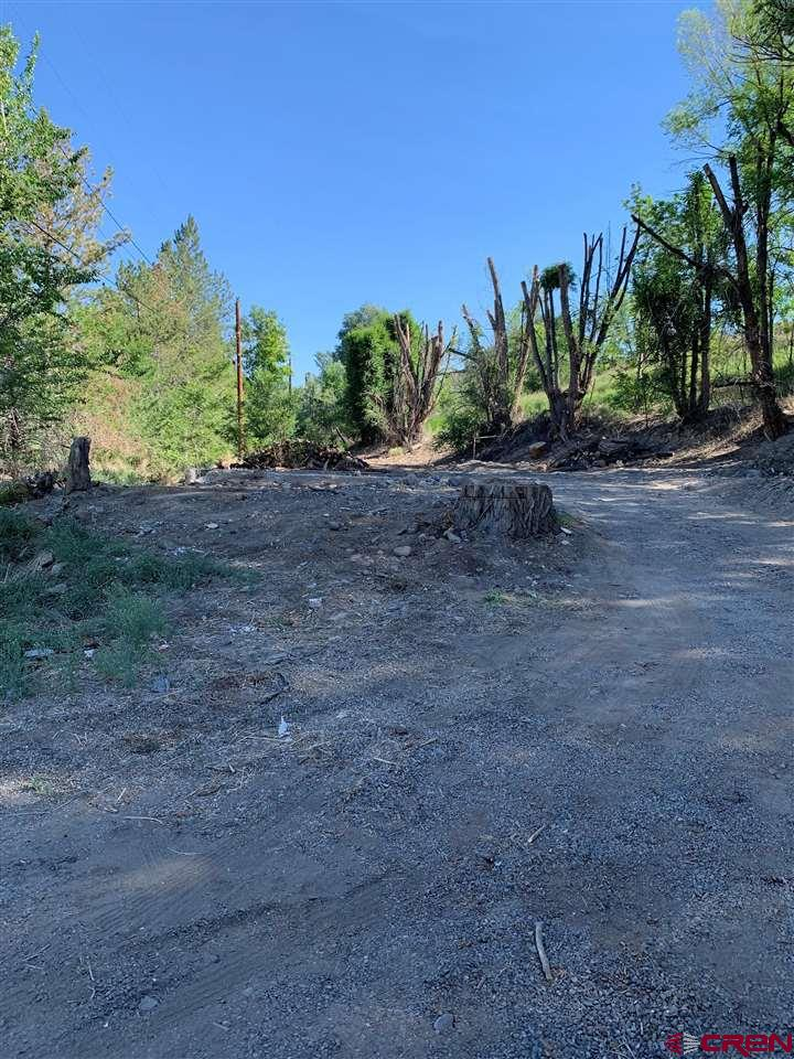"""Property is being sold """"AS-IS"""".  City of Delta water and sewer taps are included. Natural gas and electric are on the property as well.  Great building site for a single family residence.  Great location close to downtown Delta."""