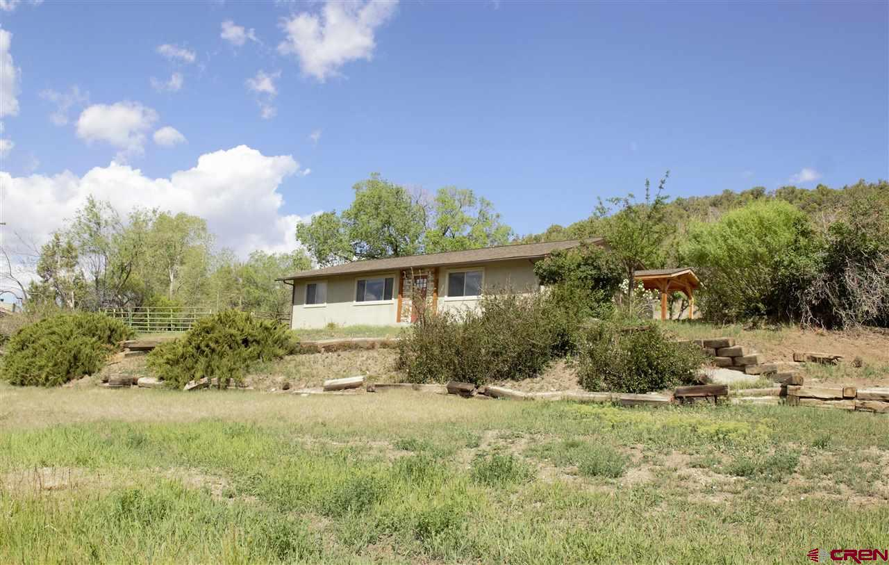"""Perched on a lovely irrigated acreage, this completely renovated """"like new"""" home enjoys stunning views of the West Elk Mountains! Wonderful features include granite countertops, new kitchen cabinets, stainless Whirlpool appliances, a pantry and gorgeous, durable hickory floors. Situated on the southern slopes of Cedar Hill just outside Paonia, the home is well-insulated, plumbed for solar and features a heat recovery ventilator system. The back and side yards encompass a horse corral and numerous shade, fruit and juniper trees.  The exterior walls are foam insulated, the attic is insulated to about R-44 and the crawl space is lined with a Visqueen sheeting vapor barrier."""