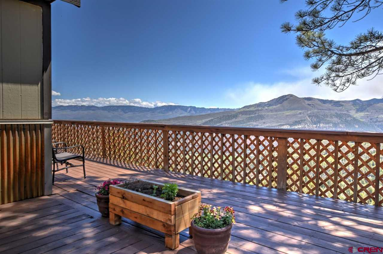 Located in Elk Meadows on 1.64 Acres on the Escarpment overlooking Miller Mesa, Park Estates & into Ouray Valley. 180 degree Unobstructed views of the Cimarron to the Grand Mesa.  Mt. Sneffles is in your direct view from the South of the home. 78 Fawn is only 15 minutes from Downtown Ridgway. This 2 bed 2 bath home features upgraded energy efficient windows in living room, Stainless steel appliances, new high-efficiency furnace and on demand water heater, new PEX plumbing and water line to the meter, new foam insulation in crawl space, new Cherry kitchen cabinets large walk-in closet,  reclaimed flooring from the Beaumont Hotel in Ouray. 78 Fawn lane includes an entertainment wet bar a wood stove with new chimney, a Detached 24 X 28 SF -2 car garage & workshop w/wood stove for heating with 220V power. Storage above garage with drop down ladder access. Approximately 820 SF of surround decking & viewing porch. Large fenced in dog run with separate overlook deck. Seller will entertain selling fully furnished, including the blue tooth record player and snow blower.  Call us to see this home today!