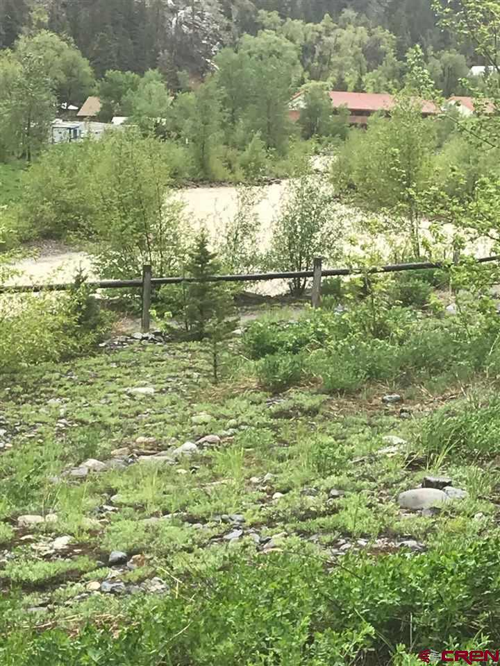 Beautiful lot on the Uncompahgre River. Great views from all directions. Utilities to the lot line. This half acre lot is in the process of being subdivided into 3 separate parcels. Currently it is one lot.