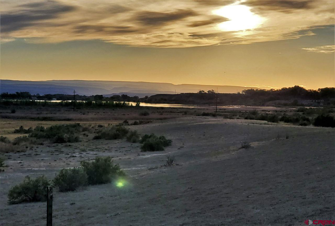 26+ acre flat Land in the Country waiting for you to build your dream home.  No Covenants or HOA's.  Property comes with approximately 12 Shares of UVWUA irrigation water.  Tri-County Water tap and installation has been paid for.   DMEA  has run the Electricity to the Property.  Black Hills Gas stops at the neighbors to the South of the land.  Come take a  look at the 360° views.   Unobstructed views of the Grand Mesa, Sweitzer State Park, Black Canyon of the Gunnison and the San Juans in the distance  Many beautiful building spots to build your dream home.