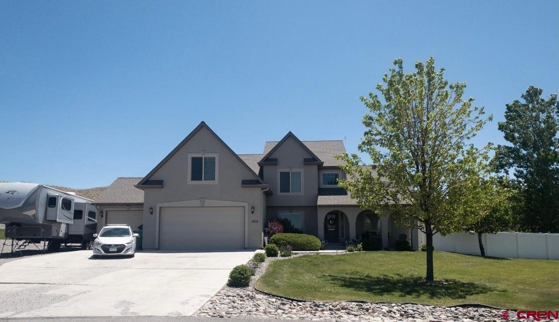 """Beautiful, maintained, well cared for house and property on a large .66 acre irrigated lot in American Village subdivision. Adjoins greenspace on one side and no other houses in the back!  Super location!  The house has all new appliances, luxury Vinyl plank and tile flooring, details in the landscaping, Smart home features (nest, Google and Ring) just ask your app, """"turn on the TV and fireplace"""". Also new light fixtures and paint!  Well thought out 4 bedroom, 3 bath with 3 car garage layout, front patio, back deck with a view, garden area,  super nice fenced in dog yard and a cute entance to the yard/kennel, trampoline and playset stay!   This house has it all.    Come take a look today!  Furnishings are available as well."""