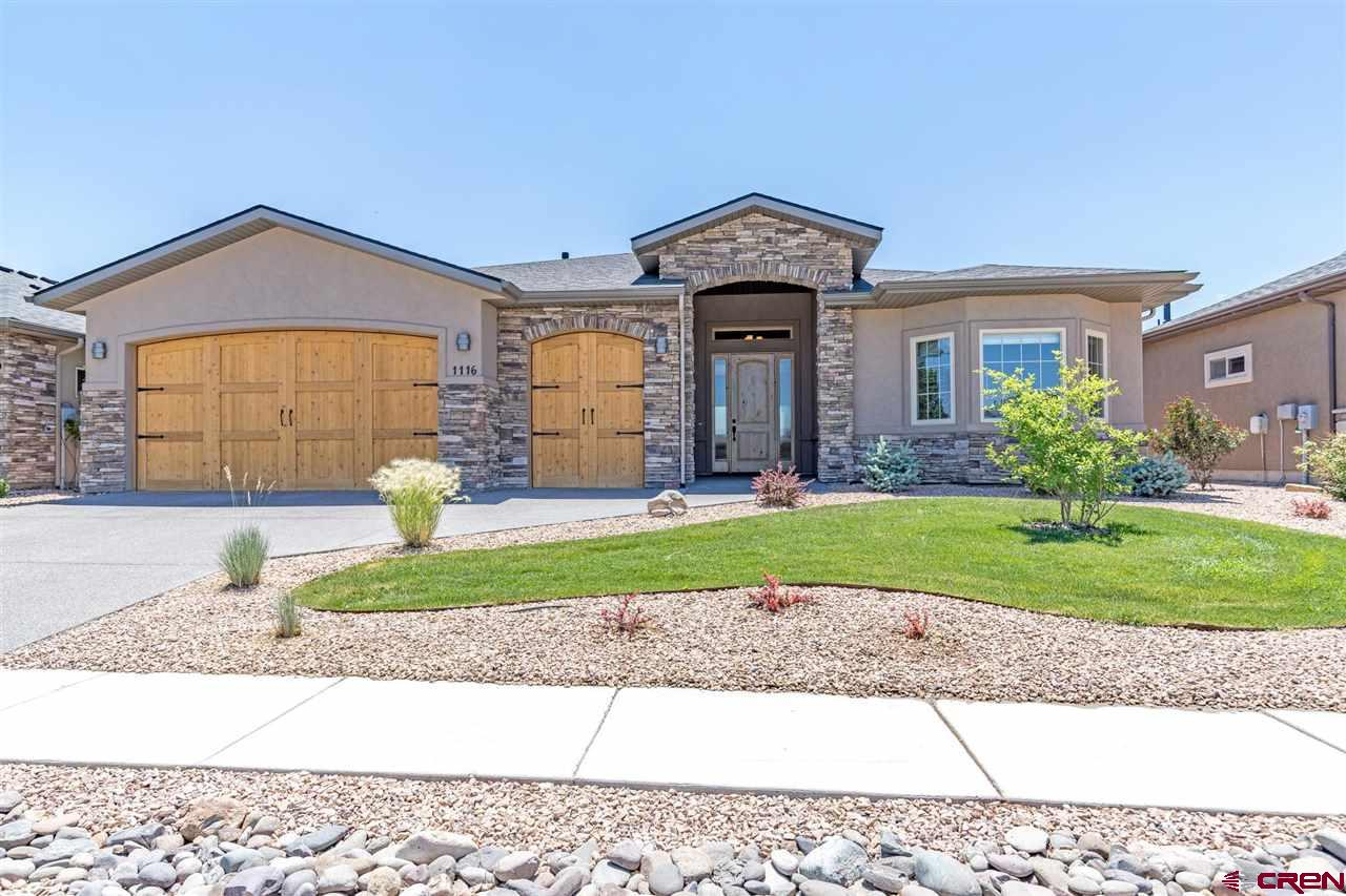 """All this in one place!!!  Wonderful home with so many extras in a great location.  You have golf across the street, and open space with beautiful views in your backyard.  You will love the heated garage in the winter - that is if you stay in the winter.  Perfect """"lock and leave"""" home as the sub-HOA takes care of the yard maintenance.  This kitchen gives you all that you would want and need to enjoy and entertain!  New Dacor gas cooktop with upgraded exhaust hood, slide out pantry, sub-zero refrigerator, upgraded granite counters, and plenty of storage.  Beautiful hardwood floors along with the upgraded plumbing fixtures throughout are a nice touch.  The stone fireplace wall will give you a cozy fire to enjoy while relaxing with a good book. Enjoy your morning coffee on the patio or your afternoon wine while the pedestal fountain gurgles nearby. You will get lost in the views of the San Juans and Cimarron mountains. You may be visited by a deer or two  while you're sitting and enjoying the outdoors.  Come and enjoy the great living here in Southwestern Colorado in this stunning home."""