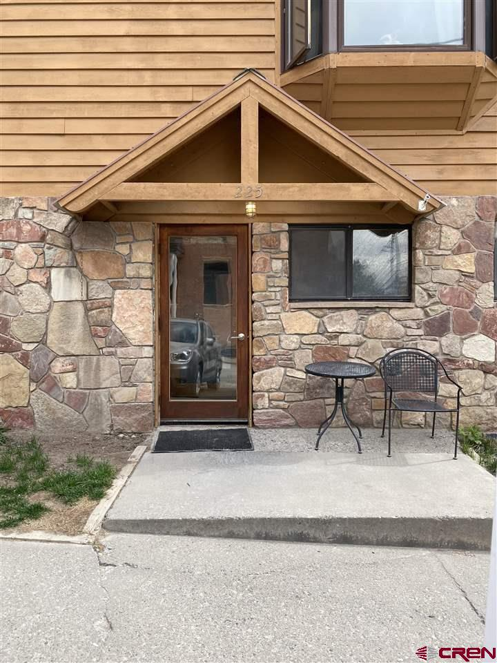 July 1 update - EASY TO SHOW.. short notice okay!  These two units, one zoned commercial and one zoned residential) have been combined into one 1140 square foot unit (currently used as residential) encompassing the entire first floor of the Sixth Avenue condos building just off of main street in the center of historic downtown Ouray. This opportunity offers tons of flexibility to create what works for you. Short term rentals permitted in this location. Currently set up a a 3 bedroom with a large living area, one bathroom and a small kitchenette. Seller has received approval to add a full kitchen and 2nd bathroom.