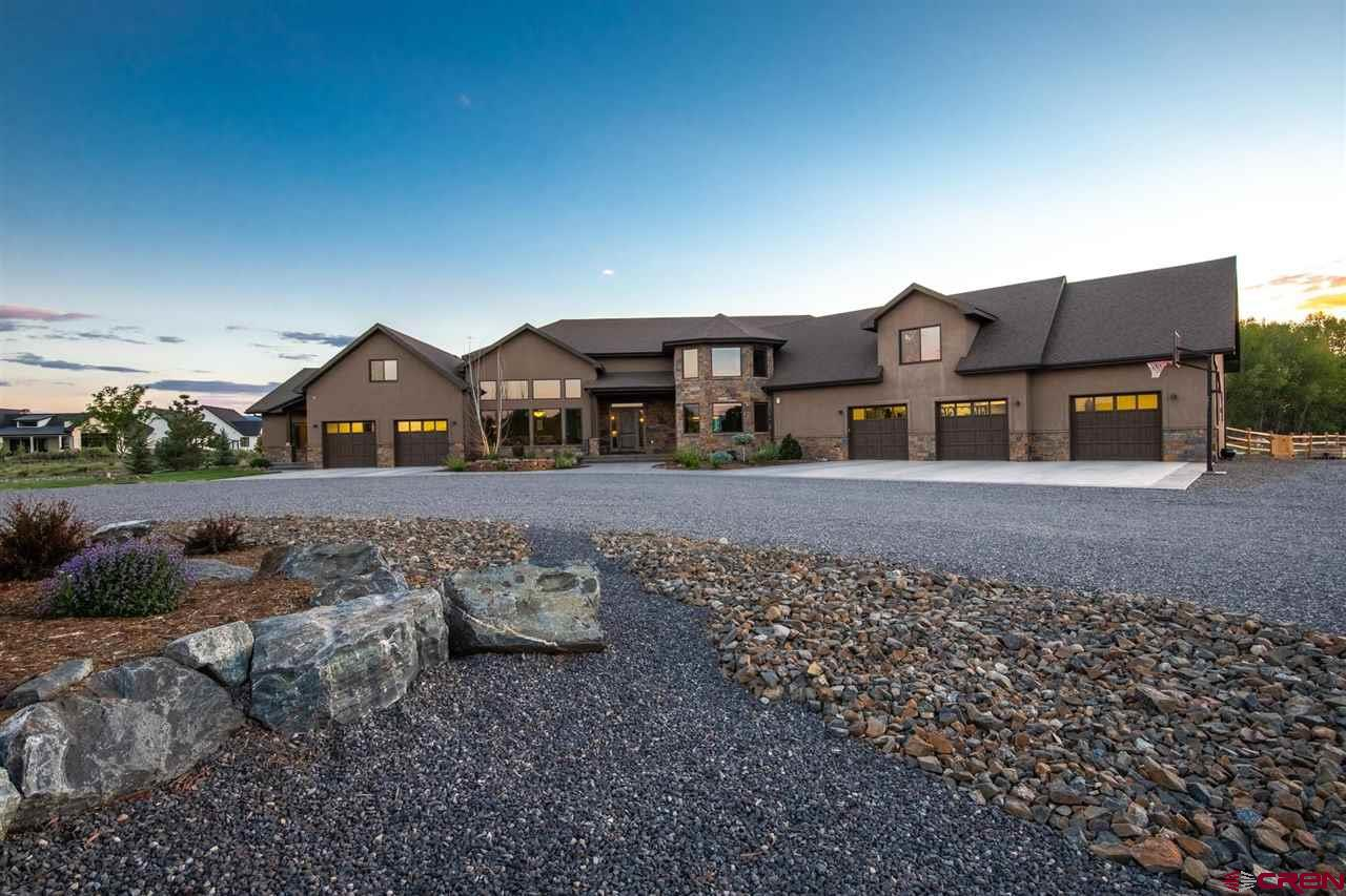 Mountain-Modern Colorado Property Adjacent to Rolling Creek on 3-Acre Estate. Convening just above Montrose Colorado on the legendary Colorado Western Slope, this stunning property will provide the ultimate mountain lifestyle for those looking for the dream base-camp location. Nestled on the edge of a private cul-de-sac, the home sits in the midst of old-growth cottonwood trees and pastoral green-scapes with San Juan mountain views in the distance. The sights and sounds of the flowing creek can be enjoyed inside through the vast western windows, or from several of the outdoor living spaces. Immerse your senses with the indulgent mountain modern home design. The interior of the home lends a sense of rustic refinement and custom touches, including a hand-forged metal iron banister, custom wood and stonework, and old-world craftsmanship. Modern home amenities provide comfort and convenience, with touches of detail: gear/mud-room cabinet customization, app-controlled surround sound, lightning-fast fiber internet, gym, woodshop, executive office, and entertainment lounge. The home gym comes complete with a roll-away garage door to the creek, matting, and sound dampening walls. Effortless entertaining and enjoyment are encouraged by the masterful chef's kitchen and fully-equipped butler's pantry. Enjoy a drink with views of the creek and noble cottonwood trees at the oversized granite slab bar. The great room, formal dining room, and breakfast nook all provide grand windows to capture the outdoor atmosphere and provide talking points for family and friends.  The fully-equipped guest suite is ideal for long-term family stays or brisk guest visits and includes a separate access door and patio, kitchen, living room, bedroom, and bathroom. Be Inspired to Take the Next Step, Your Colorado Dream Awaits. Private Tours Upon Request.