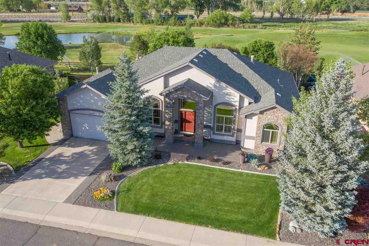 """This unique property is unlike any other in the Montrose area. On just about 1/4 of an acre & privately situated off of the 8th hole in the Cobble Creek Golf Community, this home just stands out! With just over 2500 square feet of exquisite interior space, featuring a charming master suite, 3 extra bedrooms plus an office, beautiful kitchen, & a wet bar. Vaulted ceilings, solid cherry floors throughout, over-sized two-car garage with additional storage, central vacuum system, extra sinks in the garage & on the back patio are just a few of the amazing features that make this home special. The privacy of this backyard will exceed your expectations for comfort & tranquility with the ambience of the creek that runs behind it. Enjoy coffee or cocktail as this space is suitable any time of day, & all four seasons! Every inch of this space was so well-thought out, this one won't be on the market long! Call today to set up your private showing. n  **Walk through this home virtually in 3-D with our Matterport tour, simply click the links under """"Branded & Unbranded Virtual Tours""""."""