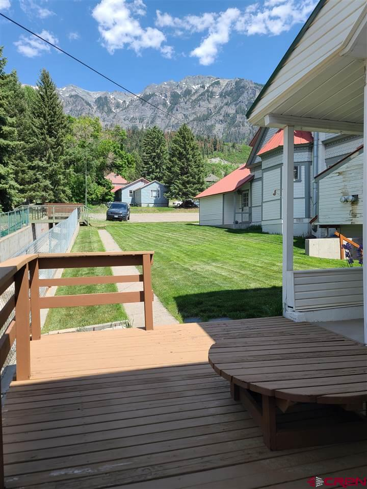 Well cared for home in Ouray. Quiet and cozy and close to everything in town. The sunny deck has great views to the amphitheater and sits next to the flume for Portland Creek. The 960 square feet feels larger because all the mechanicals - forced air and water heater - are in the large basement along with the washer and dryer. The basement also has a great workshop area. There are newer appliances in the kitchen. This home has been gently used in summers and improved over the years little by little. Cannot be short-term rented. No showings until Monday June 14th.