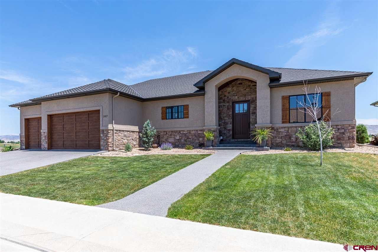 Custom Crafted 2018 Home w/ Impeccable Upgrades and Fairway Views! Quality craftsmanship and attention to detail showcase this home. The main living area and open kitchen feature oversized ceilings with peaceful views to the east, showcasing vistas of the Black Canyon National Park, San Juan Mountains, and Bridges fairway. Handsome oak hardwood floors adorn the home with knotty-alder cabinets, solid core doors, and alder trim to accent. Entertain friends and family in style; the stunning chef's kitchen features stainless steel appliances, Italian marble countertops, and convenient wall-mount double ovens. Take the festivities outside on the T&G covered back patio, complete with a built-in audio system for your own private cocktail party. The home's Spectrum internet can be converted to lighting fast Elevate Fiber Internet. The home is also smart-wired with app-controlled capabilities and also pre-wired for a security system. The home includes forced air heat, cooling, and humidifier for efficient comfort in all 4 seasons while the main living area features a gas log fireplace for added coziness and ambiance. The 3-car garage is super deep, measuring 30' in length to accommodate any size vehicle.  Make Your Next Move Count with this Carefully Crafted 2018 Home; Ask for a private tour today!