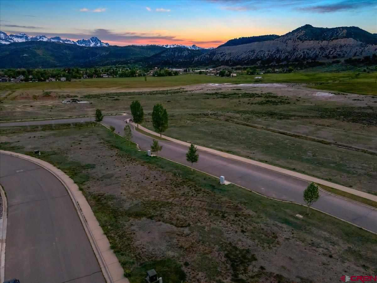 Live your dream in beautiful Ridgway Colorado!  This lovely lot is in the friendly Town of Ridgway Colorado. The Uncompahgre River meanders right outside of town.  Jeeping, Hiking and outdoor activities abound. Just 45 minutes to the Telluride ski area!  The community Garden is right out your back door on Green Street.  This wonderful property has water, electric, gas and sewer right at the property.  There is even a $7000.00 credit towards the water and sewer hook up. Owner has a set of plans they can build for you on this lot. The incredibly well designed home is super energy efficient and can be built quickly. There are solar possibilities as well.  Don't miss this opportunity!  Very few properties are available in this special location.  Live her and enjoy the Majestic views of the prettiest mountain range in Colorado, the rugged San Juans!