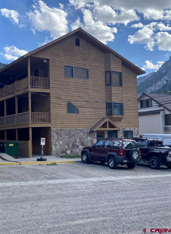 This lovely and spacious top floor condo has beautiful views. It sits in the heart of Ouray and is within walking distance to everything. The balcony overlooks the city with great views of the Amphitheater, Cascade Falls and you have a birdseye view of the water fights on the 4th of July. It has an open concept kitchen with beautiful granite countertops, along with lots of windows and light. This three bedroom, two bath condo comes furnished with the exception of the wall hangings. It's a great place to call home, or it can be short term rented. It has lots of potential and most of all, it has LOCATION!