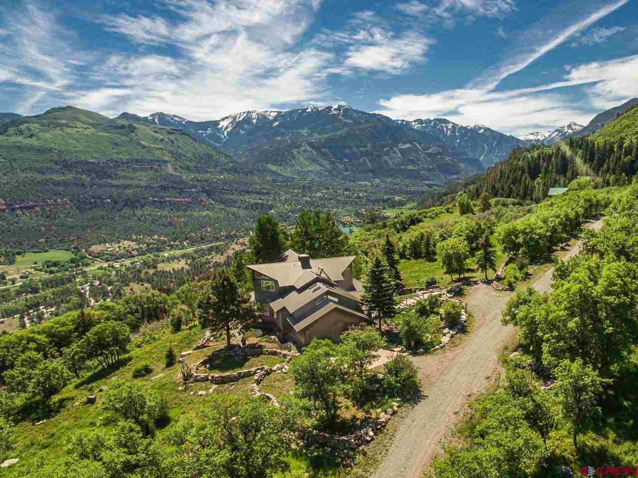 New to the market, never been listed before.  The house  overlooks the full Ouray Valley.  Designed to take in all the natural beauty of the area, views of Ouray Valley, Mt. Abrams, north to grand mesa and the red rock cliffs of the eastern side of Ouray Valley, the Uncomprahgre River and More.  The mountain architectural design of the house, allows for natural light and openness through out the home.  The open floor plan works well for gatherings or family, from the great cooks kitchen, large living room and dining room as well as a large pantry and dumb waiter for easy transferring of products from the garage.  Plenty of room for guest in 3 large bedrooms and 2.5 baths.  A fabulous library/office/den, plus a media-room/office/den/guestroom.  The exterior deck and patios offer plenty of great outdoor living space, plus enjoy the fabulous views and setting, the landscaping is a wild flower haven with flowers blooming all summer.  The home construction is very energy efficient, plus the solar that covers all the electrical costs for the year (puts it pack in the grid then get credits back for power produced ), there is also hot water solar storage as well.  Irrigation rights to irrigate around the house and small pond.  The house and property has to be seen to be really appreciated.  Ask your agent for the full list of construction details and amenities for the house and property, they can be found in the agents additional provisions.