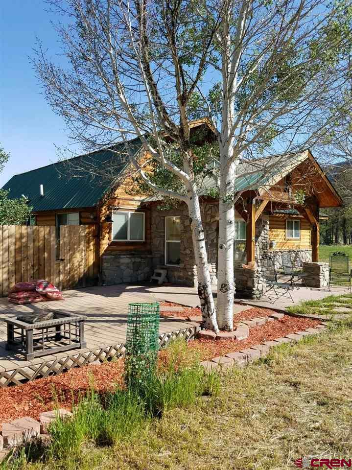 Quaint little cabin on 2 irrigated acres in Idlewild Estates. Currently a 4 bedroom 1 1/2 bath just under 1600 square feet this property has endless possibilities. Small fenced area for dogs, storage sheds, chicken coop. Bring your animals. Two acres of flat irrigated ground. Lots of trees around the home.