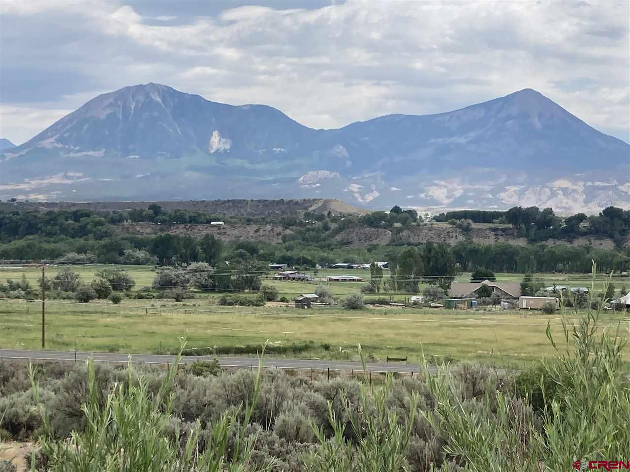 Beautiful views of the west Elks from this 8.5 acre parcel.  Farmers Ditch flows lazily through the middle of the property creating a lush, green garden like setting.  Build up on the hill behind the ditch and look out over the valley to the mountains.