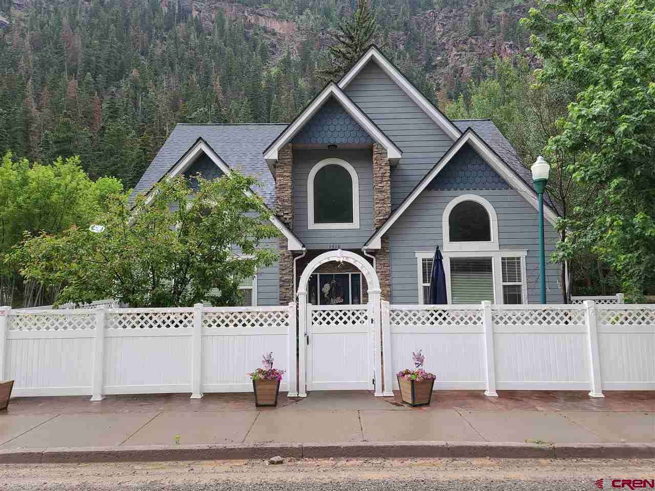 Well built 2,100 square foot 3 bedroom 3 bath home with an attached 2 bedroom 2 bath apartment in Ouray CO. The house has nice sized rooms with a vaulted ceiling in the living room.  The apartment is 1,200 square feet with a great balcony with views and has ample storage. 3 car garage and lots of parking. Both homes have vaulted ceilings, gas fireplaces, nice floorplans with a total of 3,340 square feet. Walk to town on the River trail. Can be rented long or short term and rentals are in demand. Buy the lot next door for a huge yard or parking for your toys.
